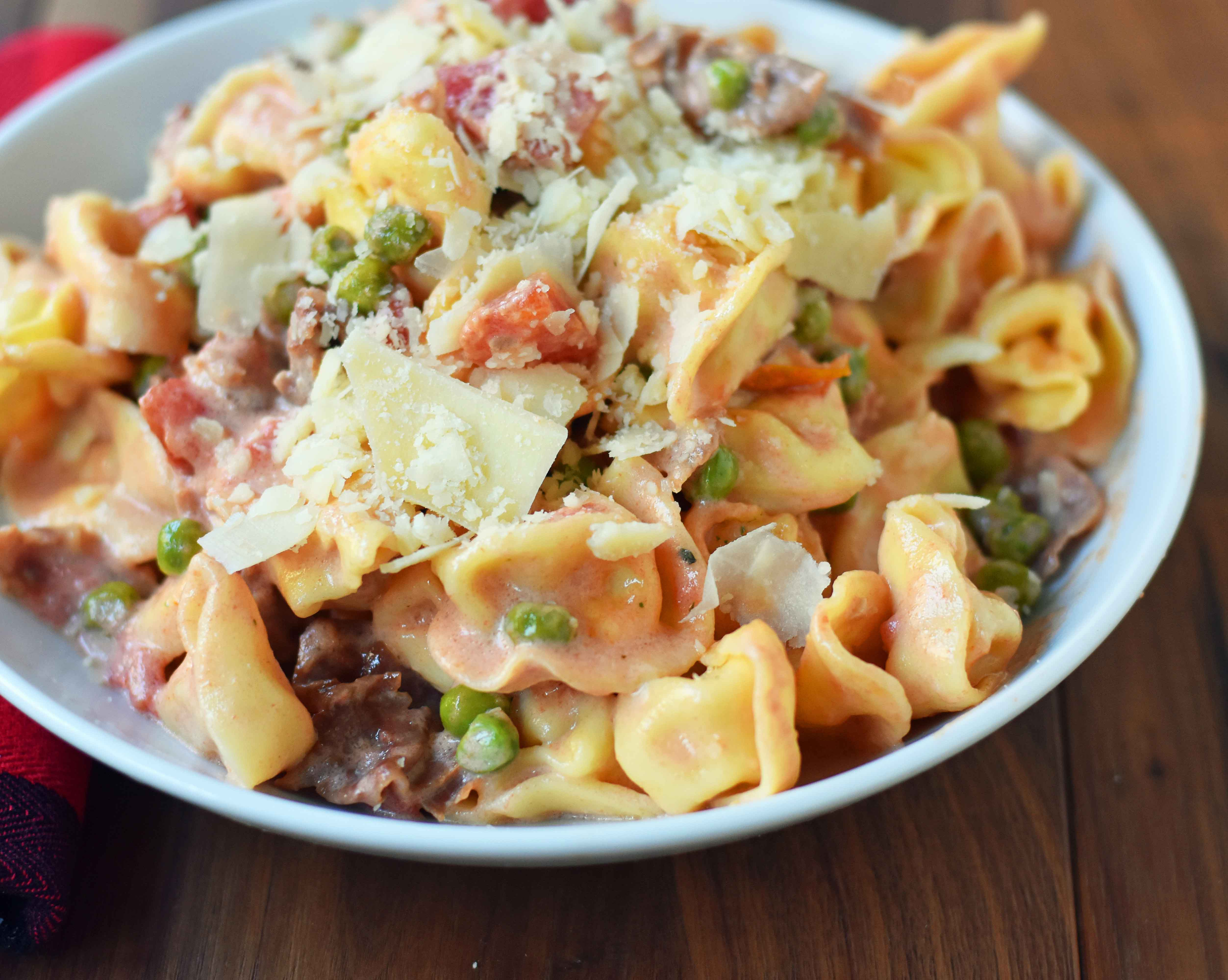 christmas tortellini pasta made with prosciutto tomato cream sauce and peas a decadent