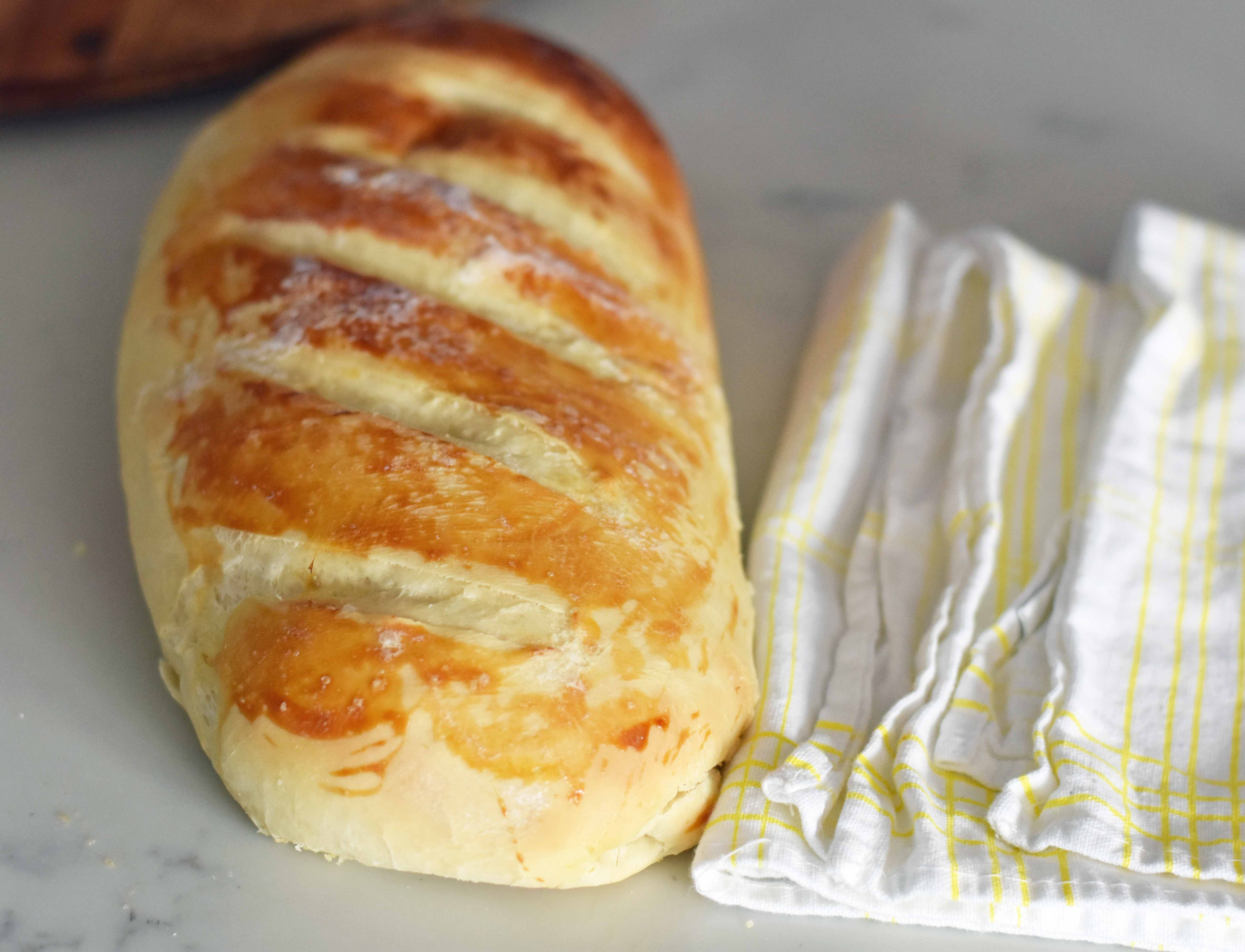 Easy Homemade Bakery French Bread. Quick and easy homemade french bread made at home. Kids can make this bread! Super easy to follow foolproof recipe. www.modernhoney.com