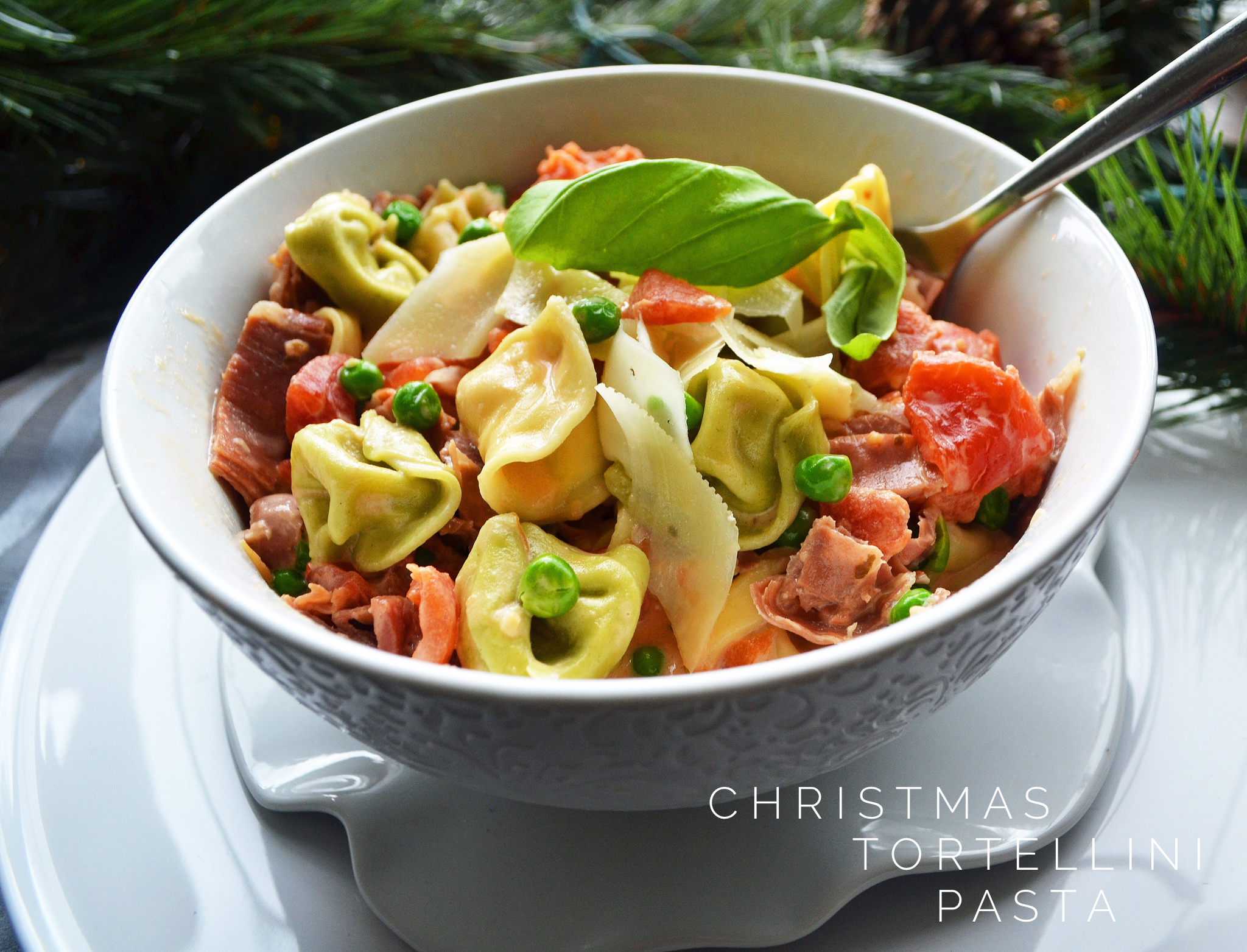 tortellini pasta with prosciutto and peas
