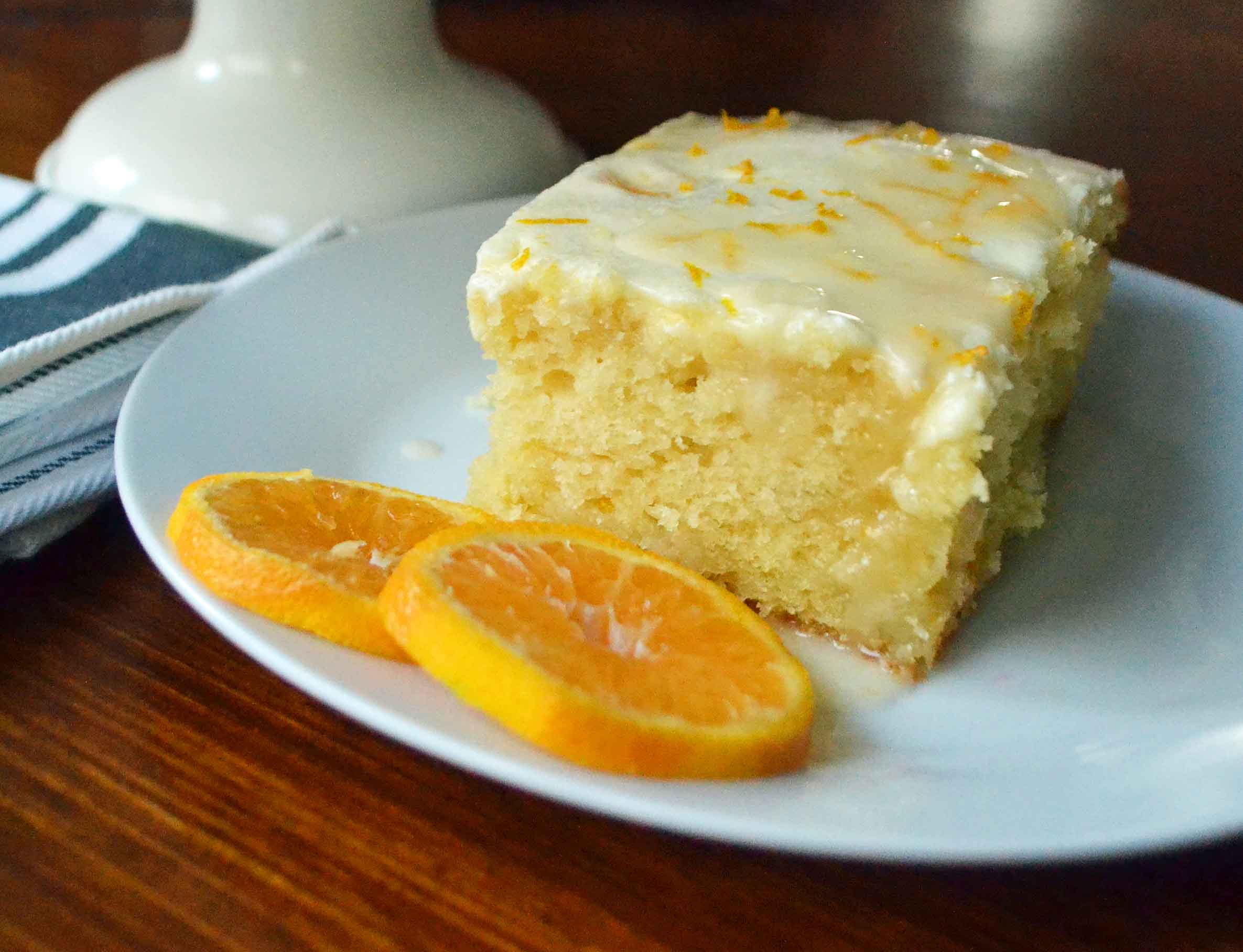 Orange Roll Breakfast Cake. A sweet orange cake with three layers of flavor -- a moist cake topped with a buttery orange topping and a sweet orange cream cheese glaze. The most amazing orange cake! Perfect for a holiday breakfast or dessert. www.modernhoney.com. Plus a wonderful egg nog and ice cream drink recipe.