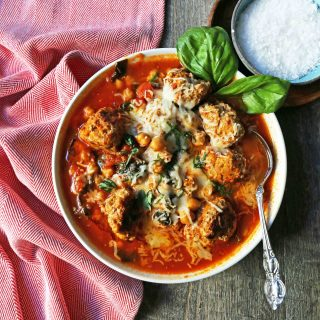 Healthy Spicy Turkey Meatball Soup A healthy soup made with lean turkey meatballs, spinach, chickpeas, marinara sauce, and parmesan cheese. Gluten-Free Turkey Meatball Soup. Low-carb soup recipe. www.modernhoney.com #turkeymeatballsoup #lowcarb #glutenfree #turkeymeatball