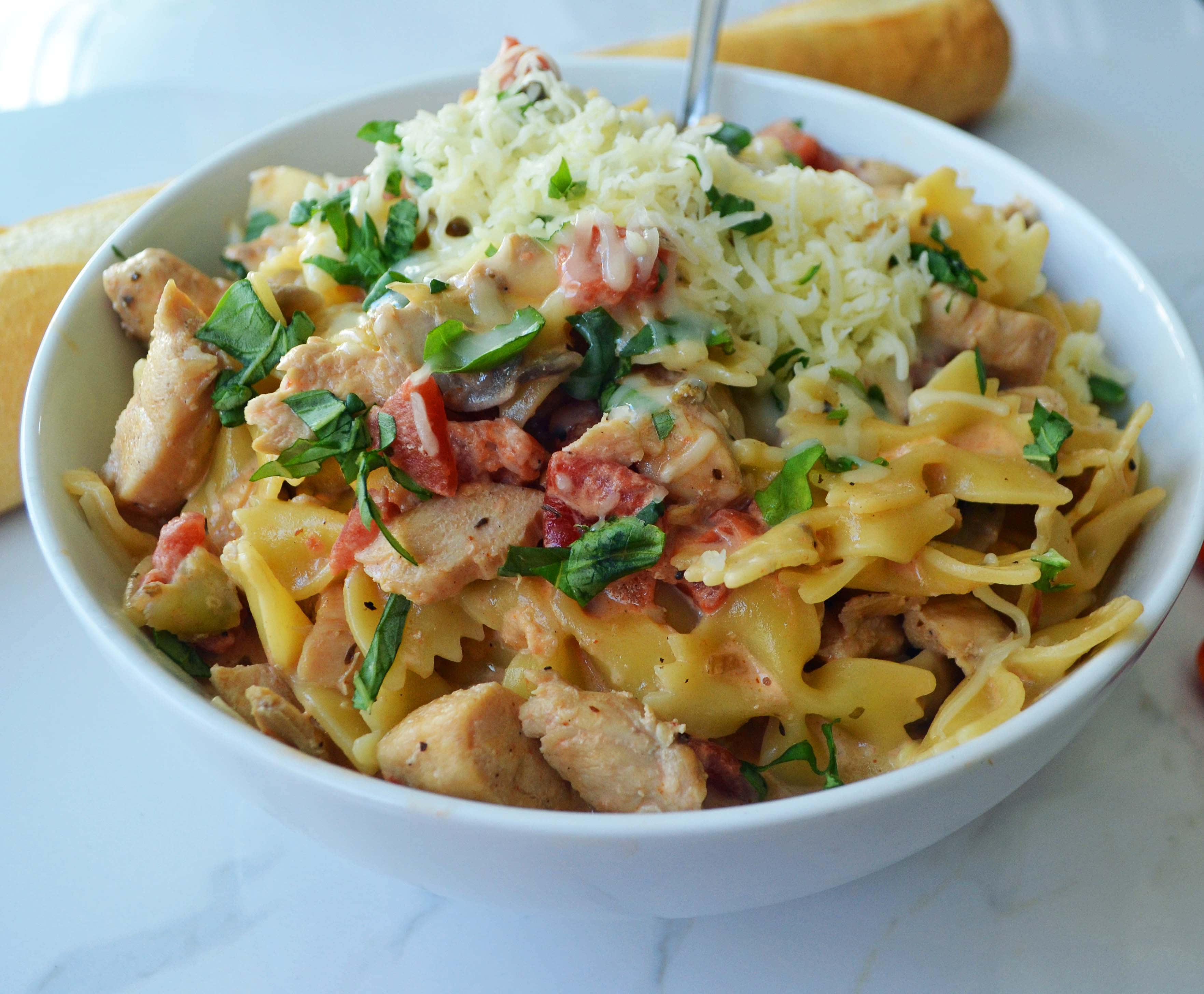 All Dressed Up Bowtie Chicken Pasta. Sauteed Chicken, Artichokes, Roasted Tomatoes, Heavy Cream, Fresh Basil, and Parmesan Cheese all tossed with Bowtie Pasta. Modern Honey - www.modernhoney.com
