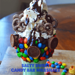 Black Tap Milkshakes Copycat Recipe. Salty Sweet Candy Bar Milkshake made with Vanilla Ice Cream, M & M's, Peanut Butter Cups, Chocolate Covered Pretzels, Hot Fudge, and Whipped Cream. www.modernhoney.com