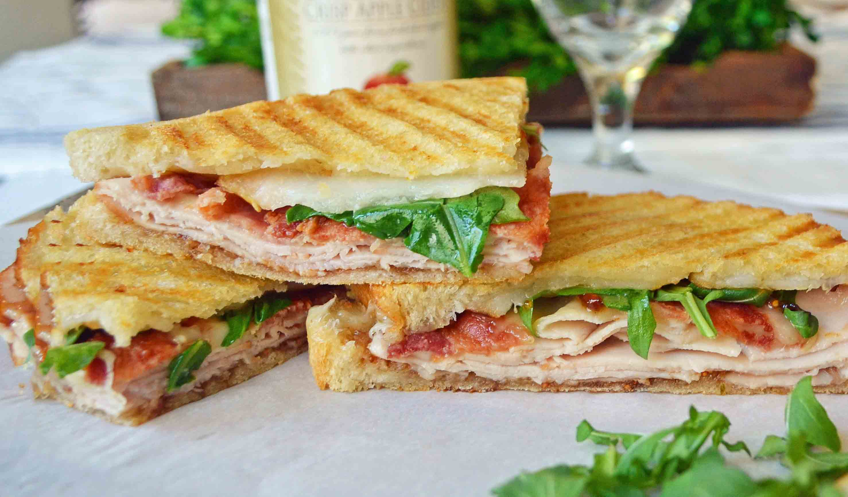 Turkey Bacon Panini with turkey, creamy havarti cheese, crispy bacon, fig spread, arugula, all on a buttered toasted bread. The perfect turkey bacon sandwich! www.modenrhoney.com
