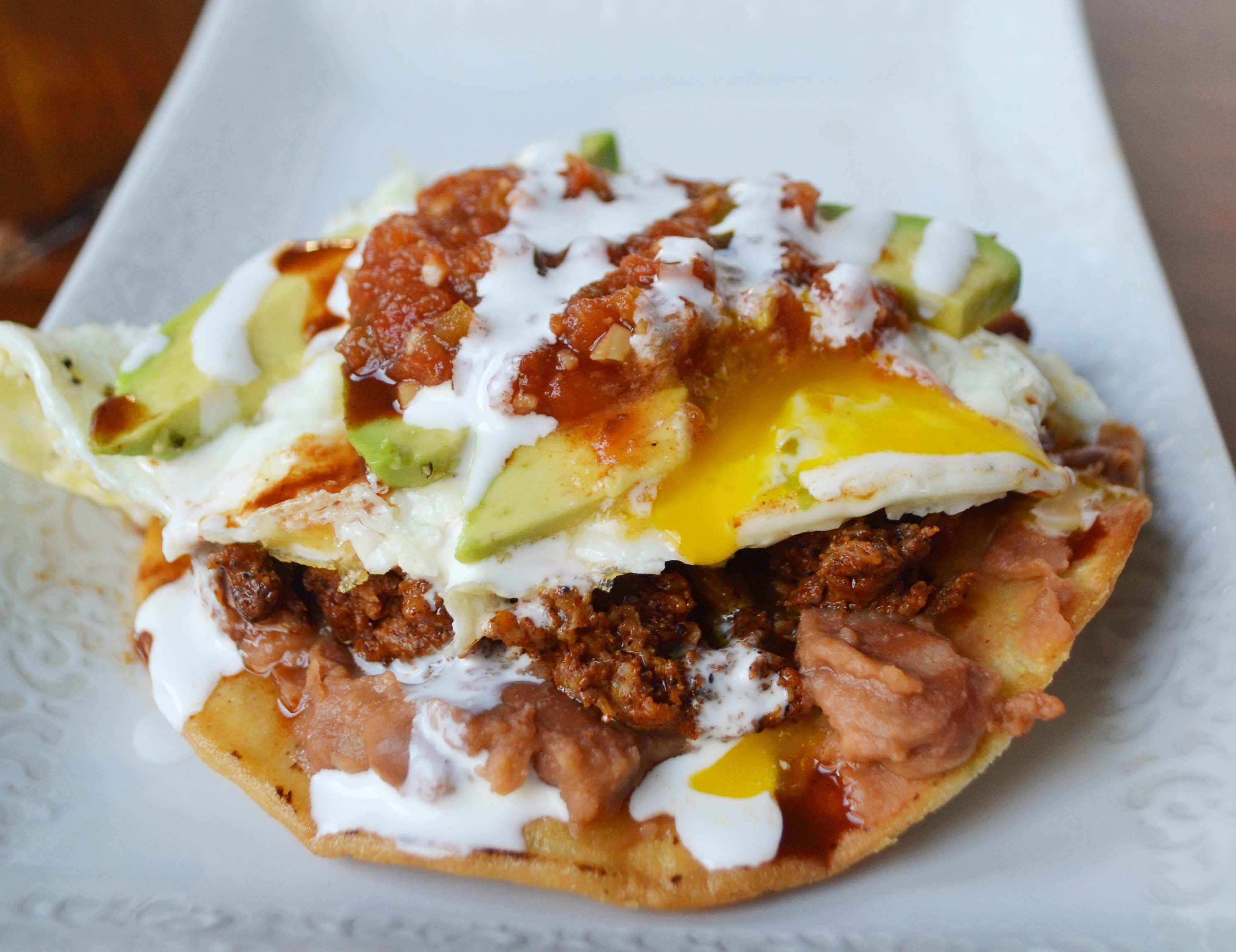 Chorizo Huevos Rancheros Tostadas by Modern Honey - www.modernhoney.com
