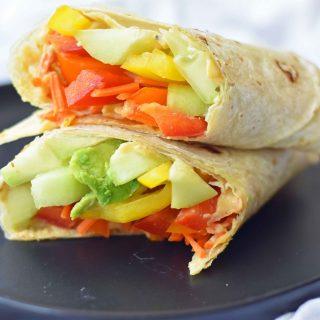 Hummus Veggie Wraps. Homemade avocado ranch hummus with veggies rolled into flour tortillas. Healthy veggie wraps. www.modernhoney.com #healthy #wraps #healthywraps #veggiewraps