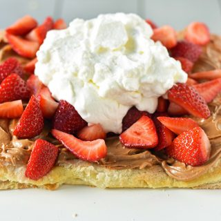 Lovebird Biscoff Cookie Butter Puff Pastry with fresh Strawberries. An easy dessert made with frozen puff pastry sprinkled with sugar and baked until golden. Topped with biscoff cookie butter and fresh strawberries.
