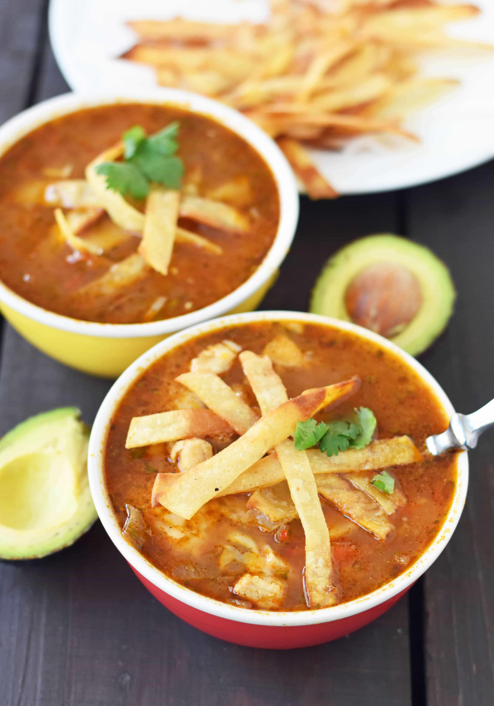 Homemade Chicken Tortilla Soup. The BEST Chicken Tortilla Soup made with tender chicken, Mexican spices, and homemade tortilla strips. www.modernhoney.com