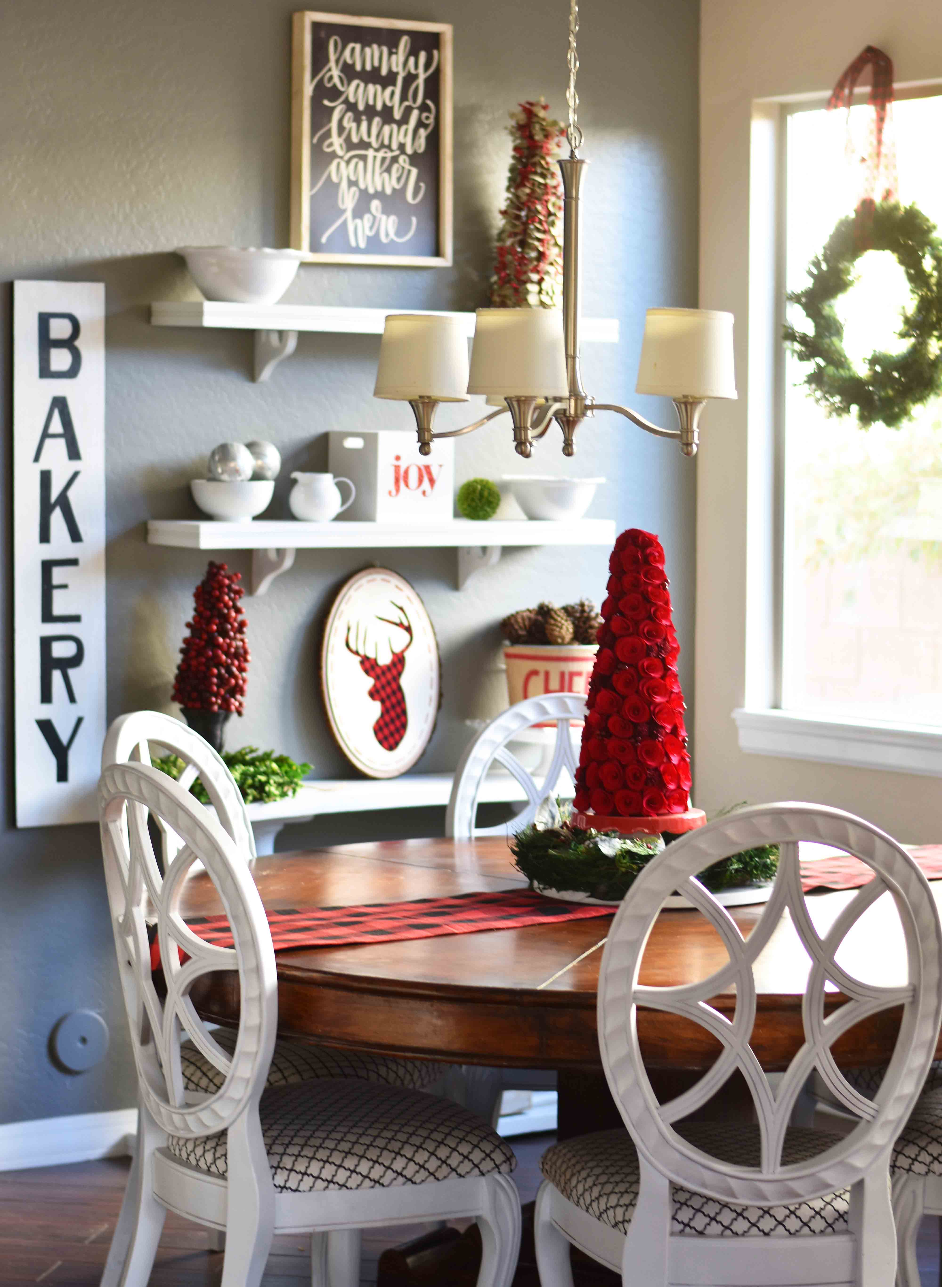 Christmas Decor Ideas. Farmhouse Christmas decorating ideas. Buffalo Plaid Christmas, Red Christmas Topiary, Natural Green Wreaths. A Magnoila House Christmas. www.modernhoney.com