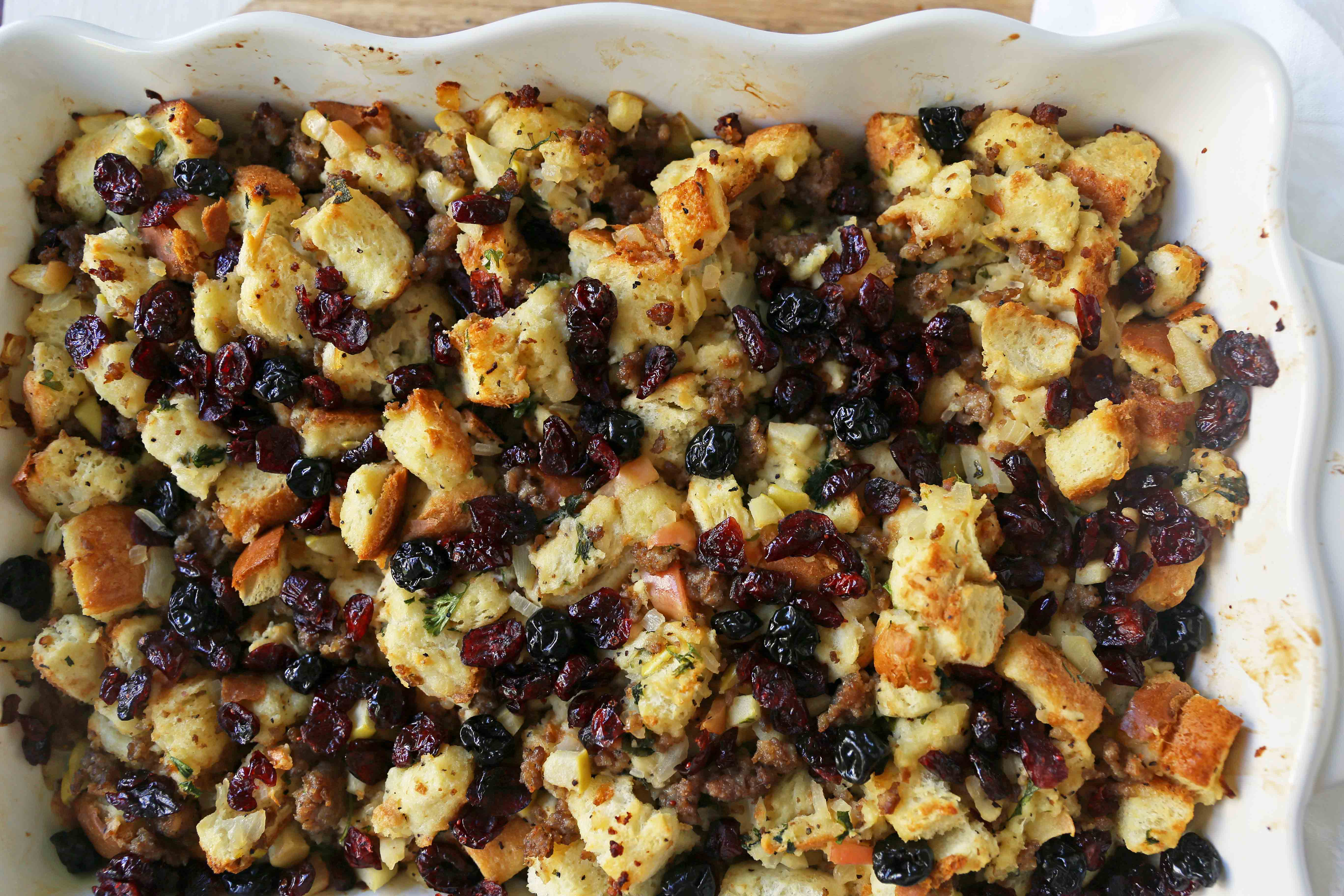 Cranberry Apple Sausage Stuffing. A classic Thanksgiving side dish that is a real crowd pleaser! Homemade Sausage Cranberry Apple Stuffing Recipe. www.modernhoney.com #stuffing #sausasgestuffing #cranberryapplestuffing #sausageapplestuffing #thanksgiving #thanksgivingsides