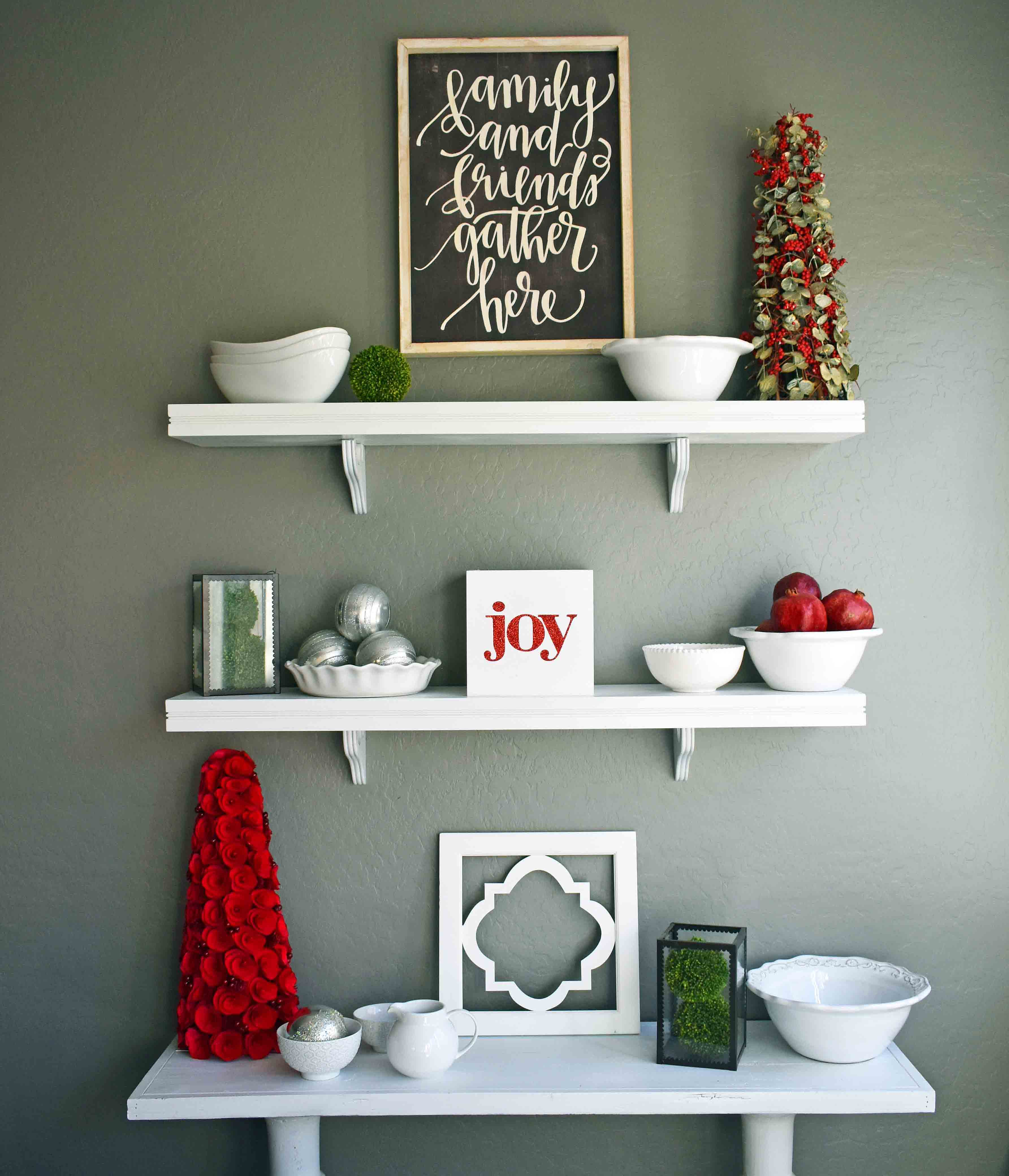 Christmas Decor Ideas by Modern Honey. Beautiful ways to transform your home for Christmas. White wall shelving with white dishes for kitchen.