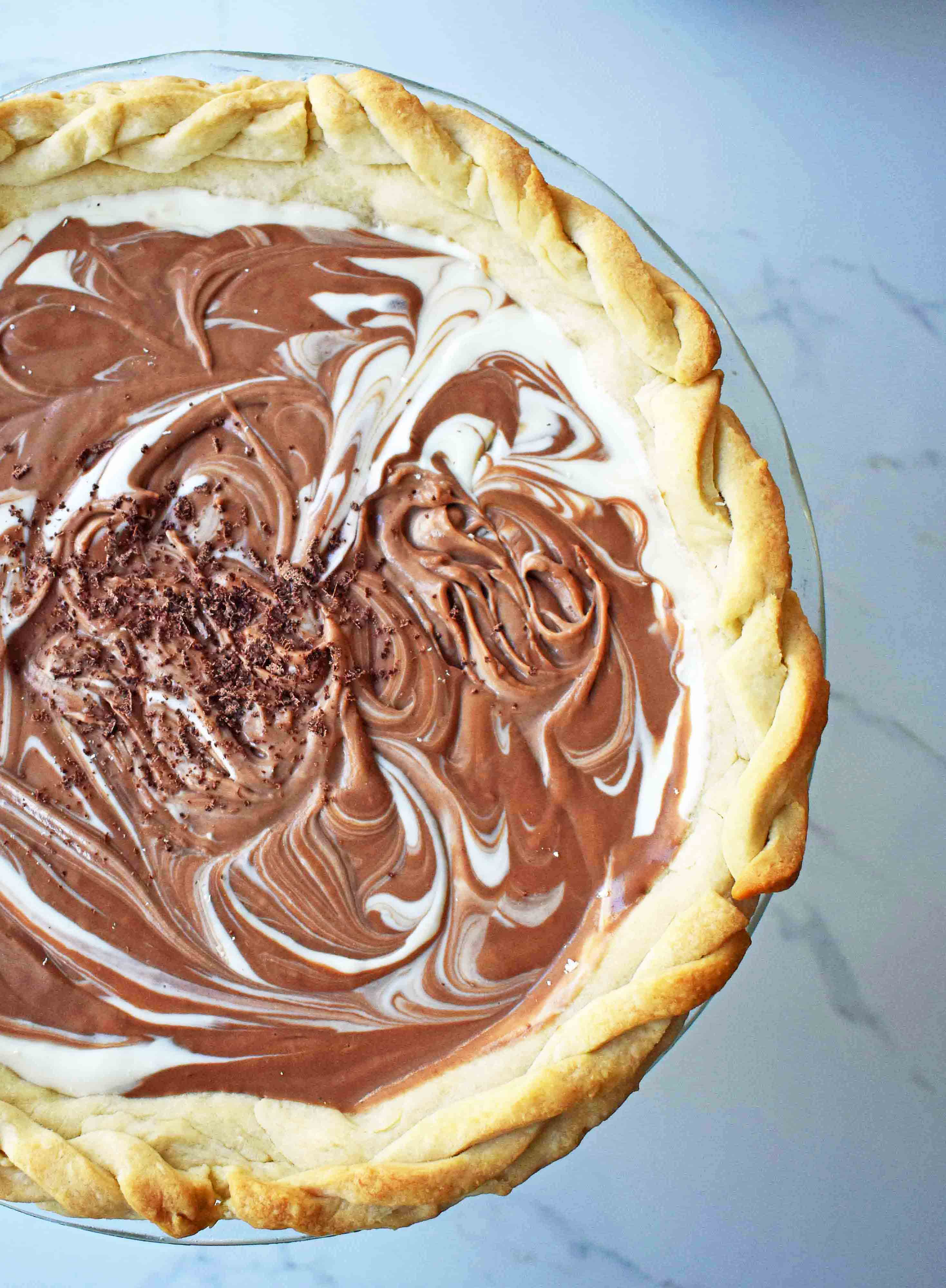 Chocolate Marshmallow Marble Pie. Chocolate Marshmallow Cream swirled together with White Chocolate Marshmallow Cream for a rich, decadent, popular pie.