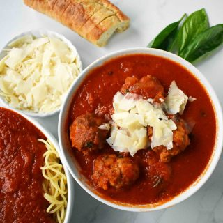 Mama's Best Ever Spaghetti and Meatballs by Modern Honey. Homemade meatballs made from scratch. Authentic Italian meatballs and marinara sauce.