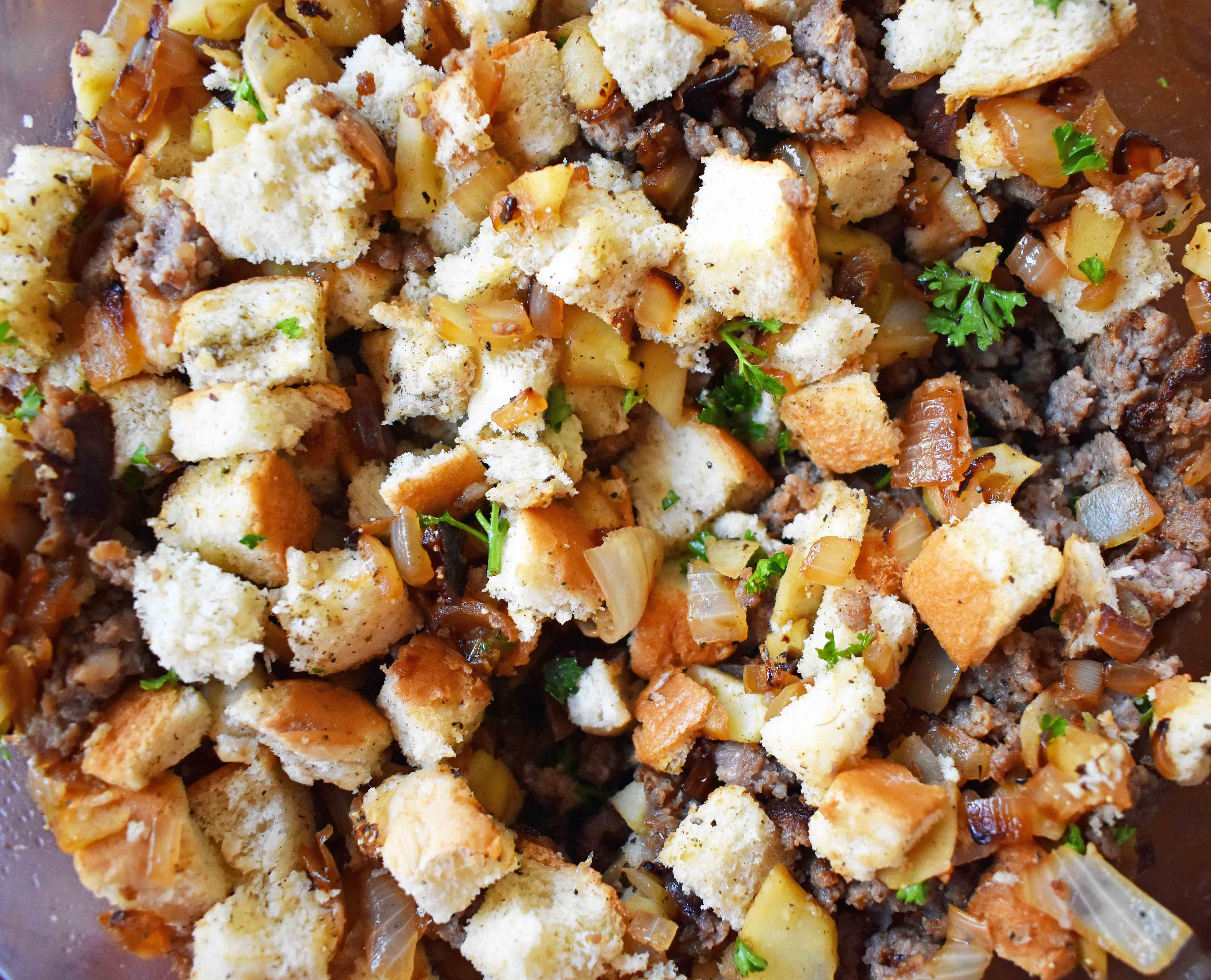 Cranberry Apple Sausage Stuffing by Modern Honey. Classic Bread Stuffing with Sausage, Dried Cranberries, and Crisp Apples. The perfect Thanksgiving side dish recipe!