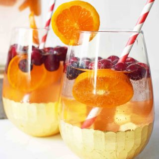 """""""The Henry"""" Cranberry Orange Mocktail by Modern Honey. Cranberry Sprite, Vanilla, Fresh Oranges and Cranberries. A perfect non-alcoholic party drink."""