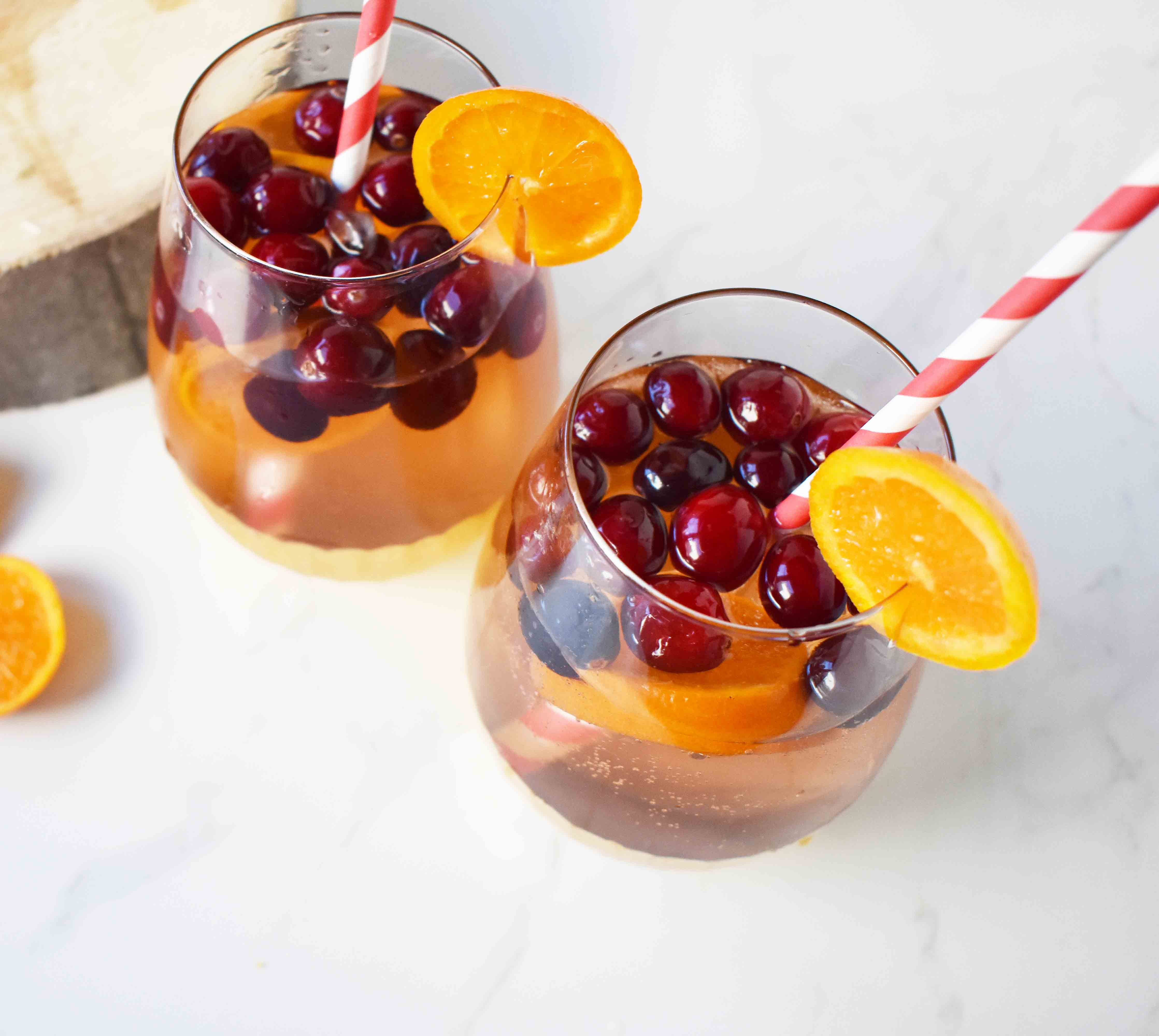 """The Henry"" Cranberry Orange Mocktail by Modern Honey. Cranberry Sprite, Vanilla, Fresh Oranges and Cranberries. A perfect non-alcoholic party drink."