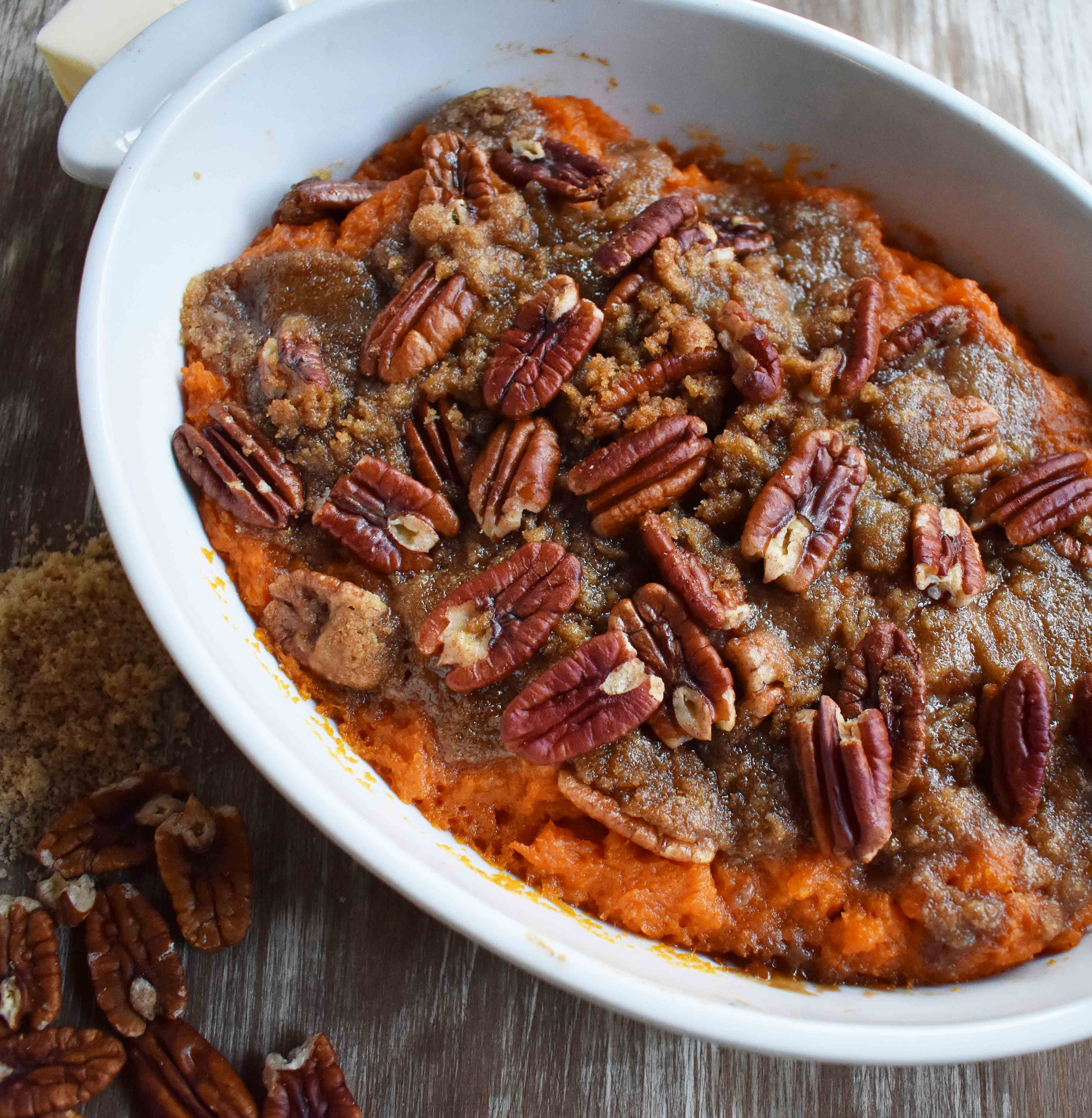 Sweet Potato Brown Sugar Pecan Bake by Modern Honey. Vanilla Cinnamon Sweet Potato sprinkled with Brown Sugar Pecan Topping. It's the perfect side dish.