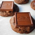 Ghirardelli Squares Chocolate Cookies. Double Chocolate Cookies topped with a creamy Ghirardelli square chocolate. Milk Chocolate Caramel, Dark Chocolate Mint,or Peppermint Bark Ghirardelli Squares are placed on top of this decadent cookie. A crowd favorite!