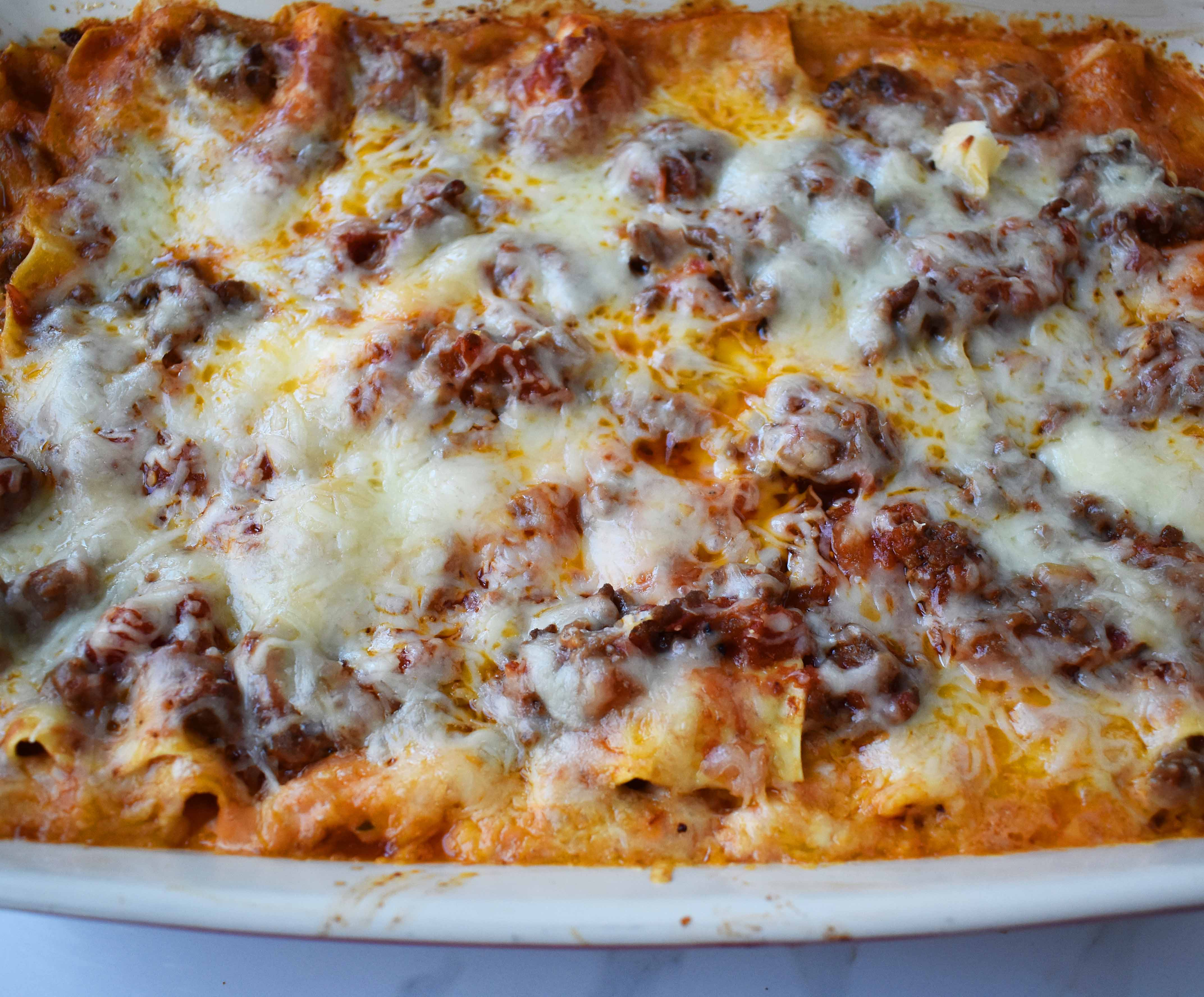 Italian Bolognese Lasagna. Authentic Italian recipe made with a traditional meat sauce, a creamy bechamel sauce, parmesan and mozzarella cheeses.