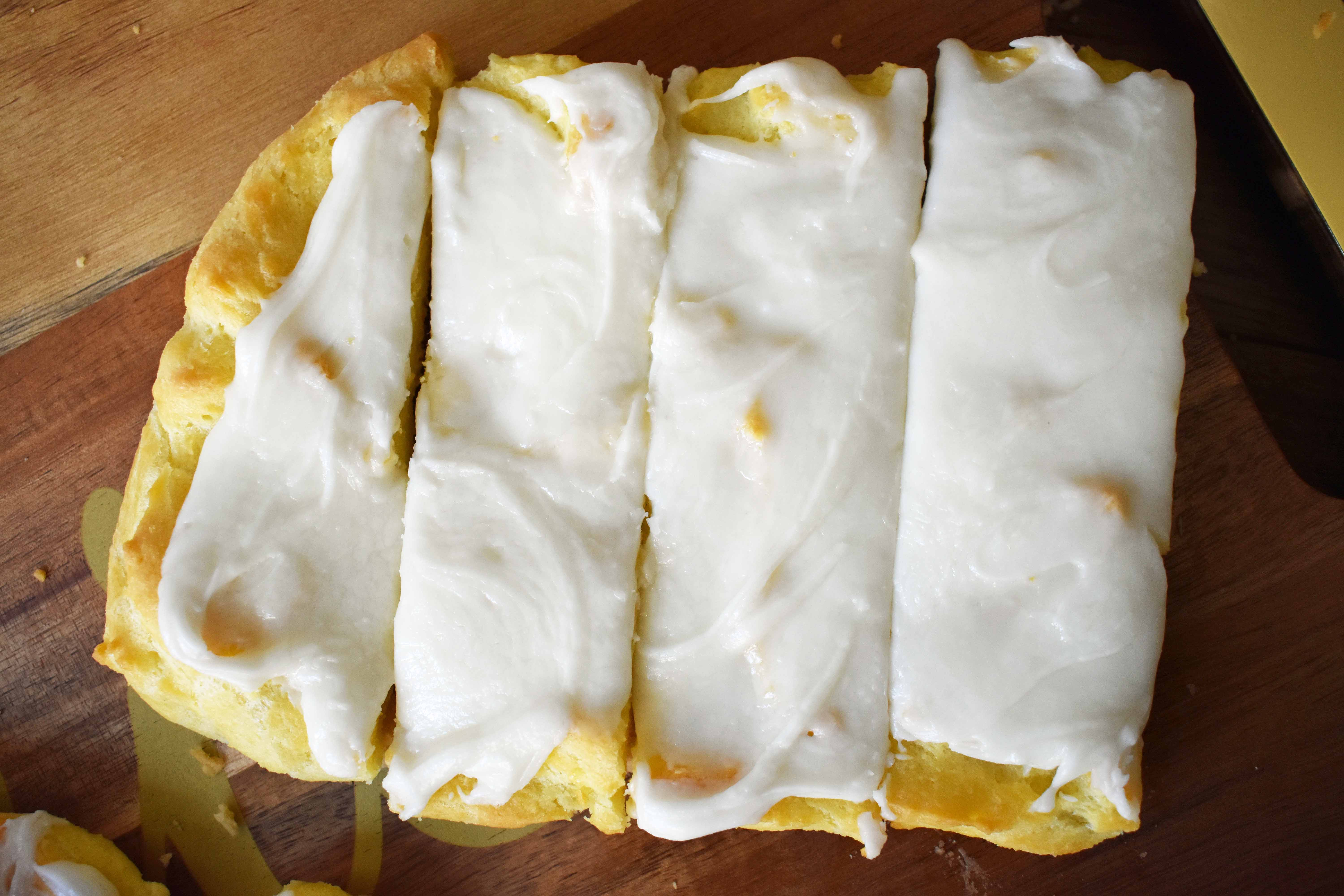 Swedish Pastry by Modern Honey. Buttery flaky layers with almond filling and topped with sweet cream frosting. A popular homemade European pastry.