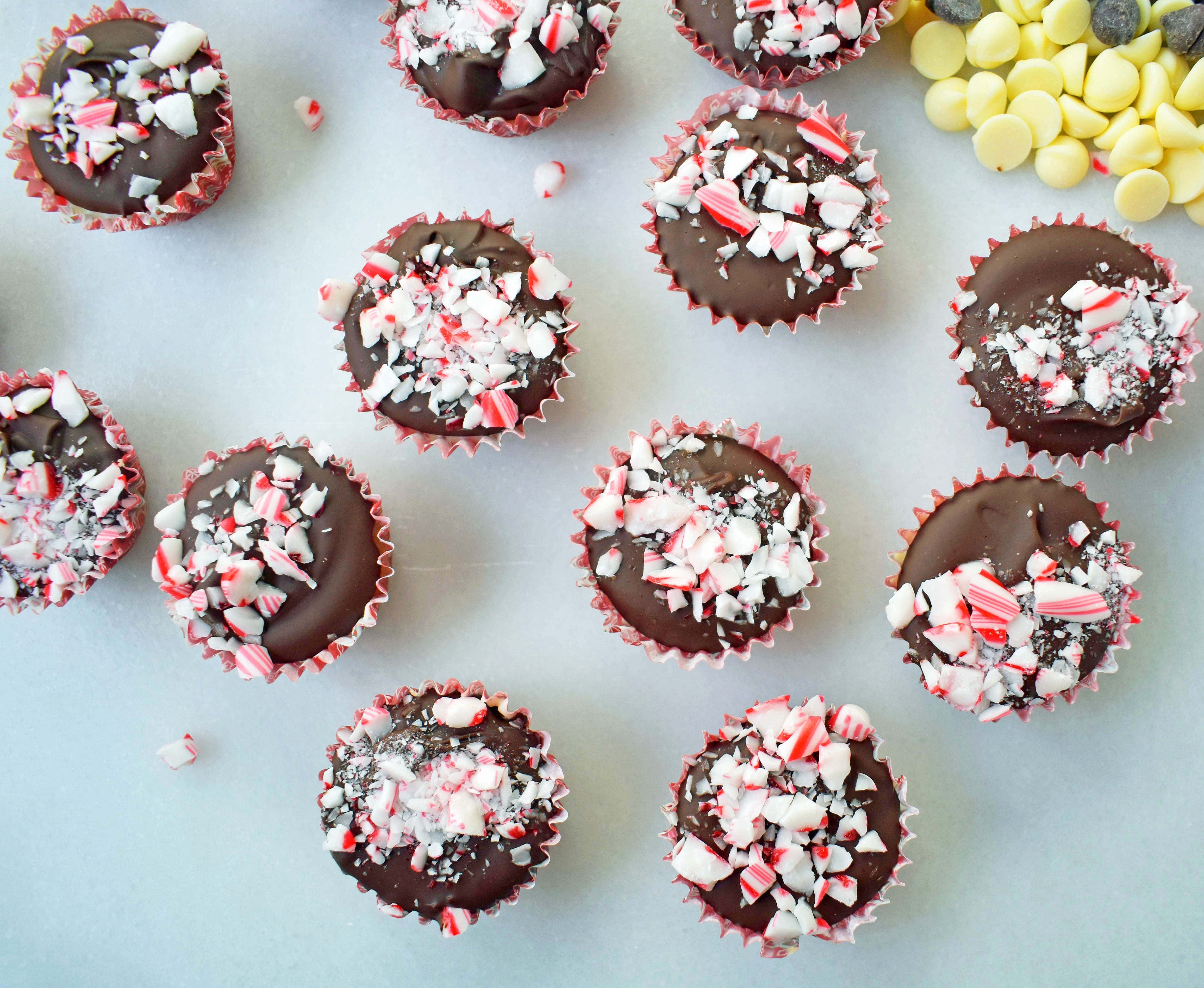 Peppermint Bark Cookie Dough Cups by Modern Honey. Egg Free Chocolate Chip Cookie Dough layered with white chocolate and semisweet chocolate and topped with crushed candy canes.