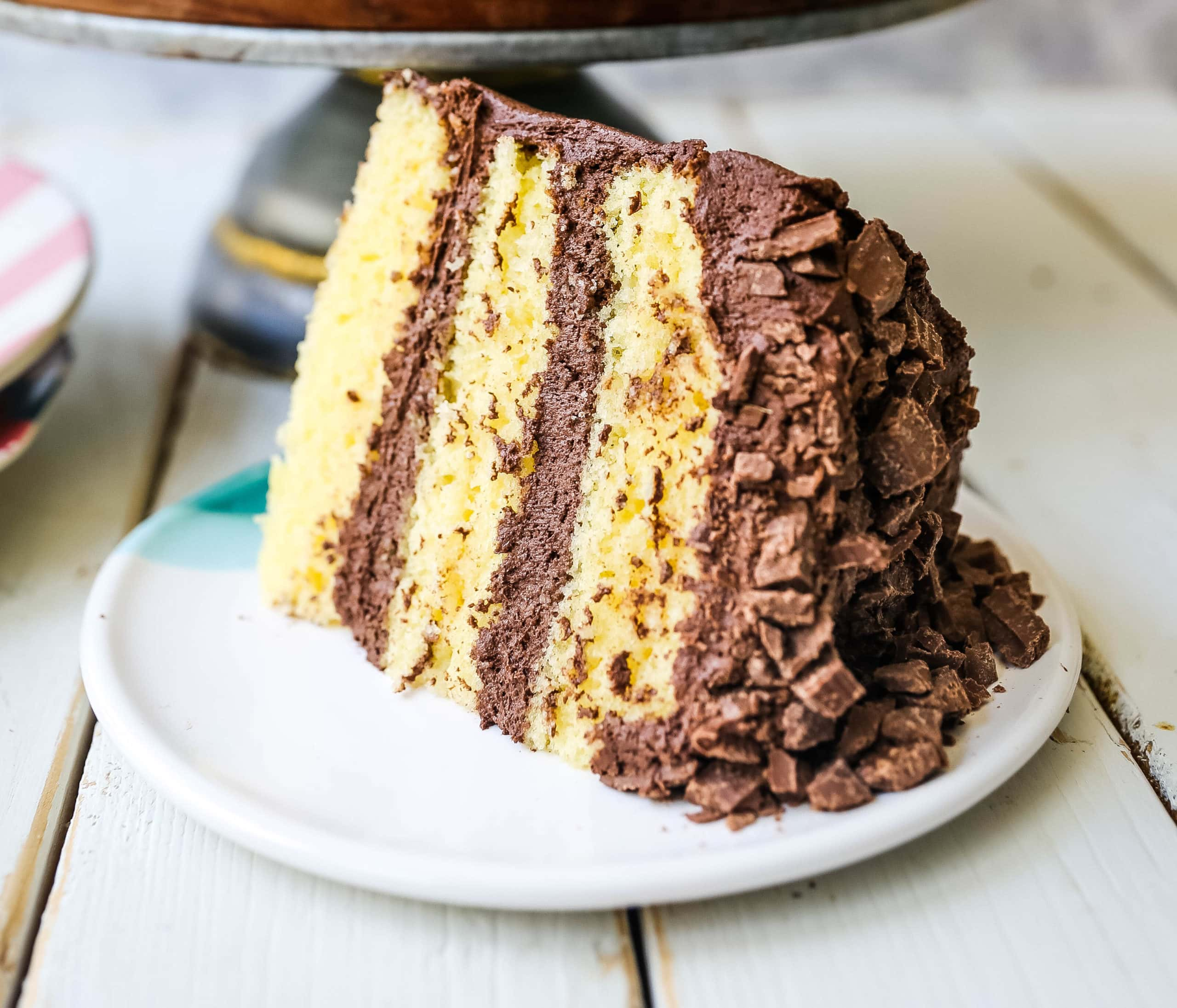 Yellow Cake with Chocolate Frosting The BEST Yellow Cake Recipe with Milk Chocolate Frosting. 5-Star Rated Recipe! www.modernhoney.com #yellowcake #homemadecake #cake #yellowcakechocolatefrosting #baking