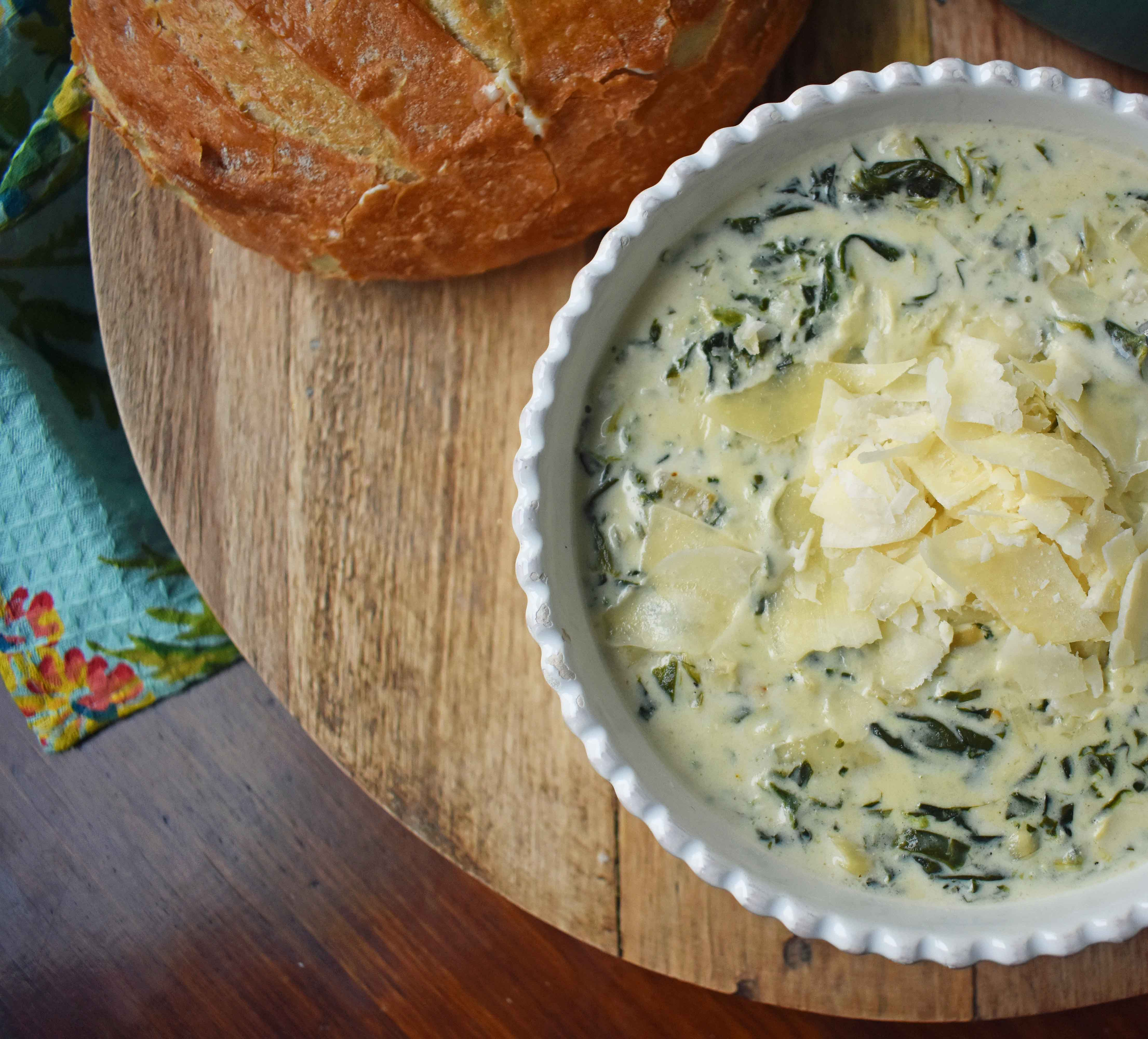 Creamy Spinach Artichoke Soup by Modern Honey. Rich and creamy parmesan cheese cream soup with spinach and artichokes. Perfect soup for a cold winter's day. www.modernhoney.com