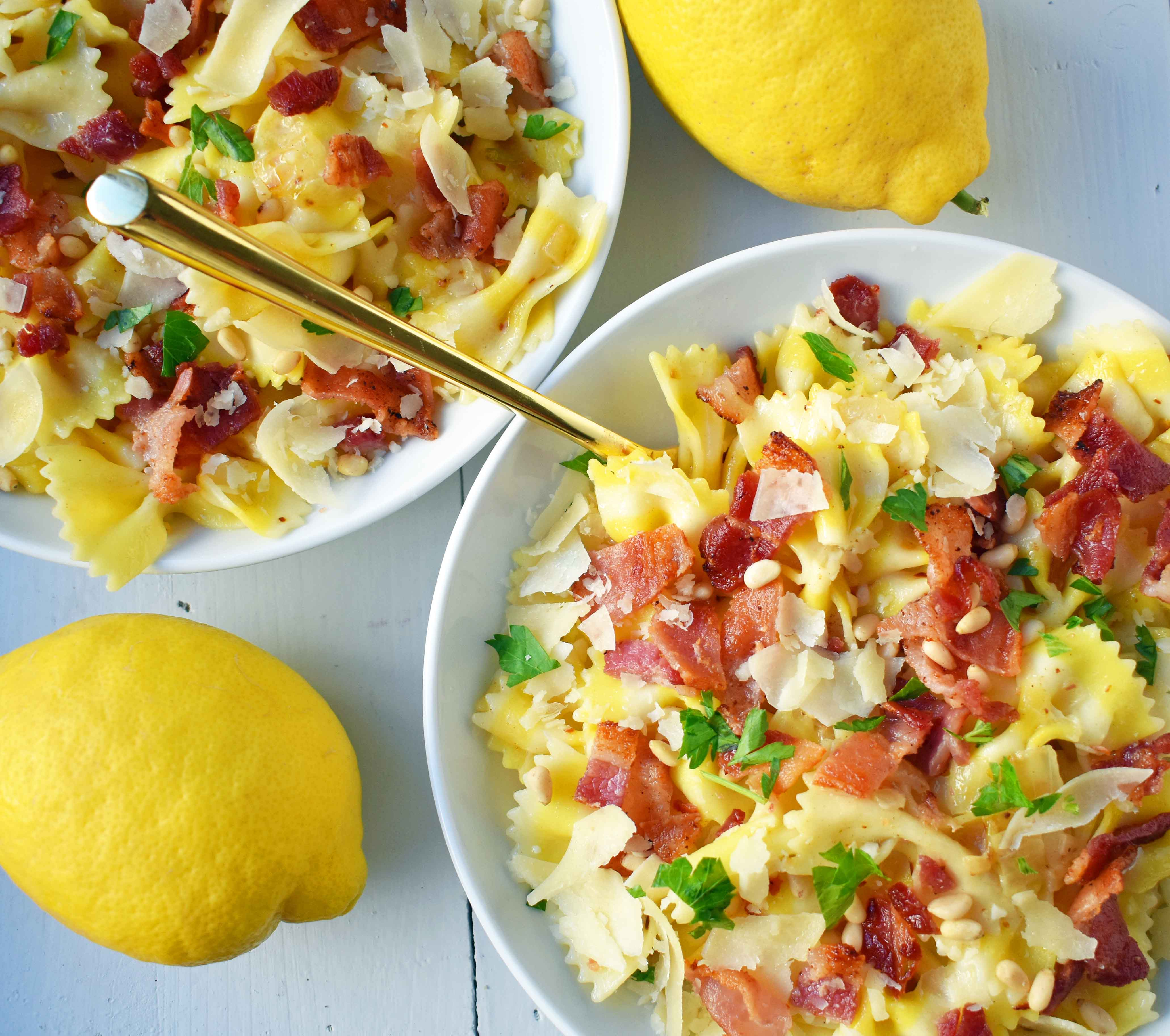 Lemon Garlic and Crispy Bacon Pasta. Farfalle, bowtie pasta, with butter, caramelized onions, and garlic all topped with crispy bacon, parmesan cheese, and pine nuts. A light and fresh pasta with lemon butter and bacon. www.modernhoney.com