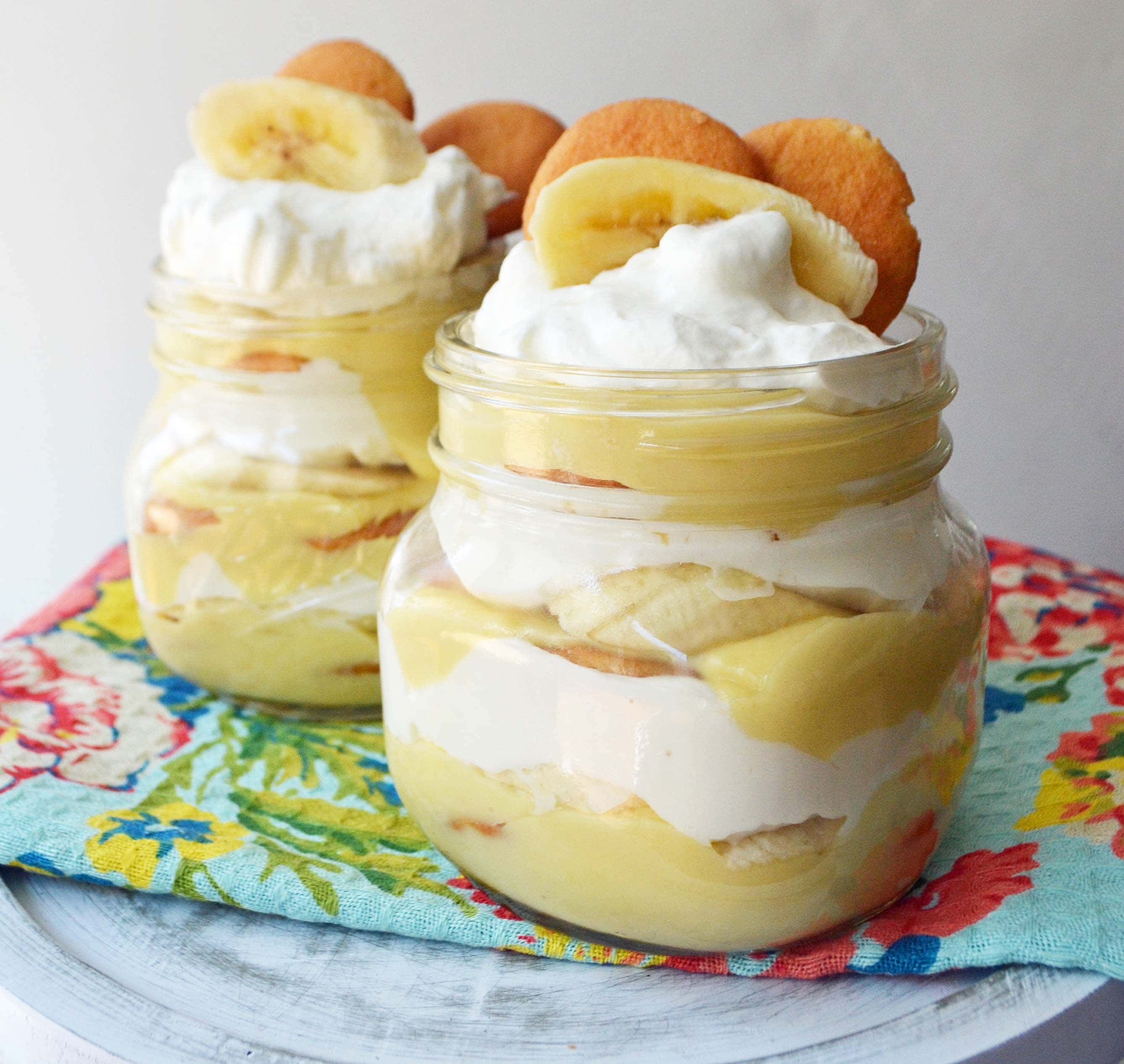 Homemade Banana Pudding Dessert Recipe. Slow cooked vanilla bean custard layered with fresh bananas, nilla wafers and fluffy whipped cream. A perfect Southern dessert and homemade Magnolia Bakery copycat with made from scratch pudding. www.modernhoney.com