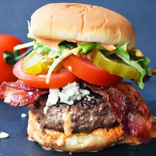 Dragonslayer Burger. Beef with blue cheese, crispy bacon, juicy tomatoes, crunchy pickles, spring mix, and buffalo ranch sauce. www.modernhoney.com