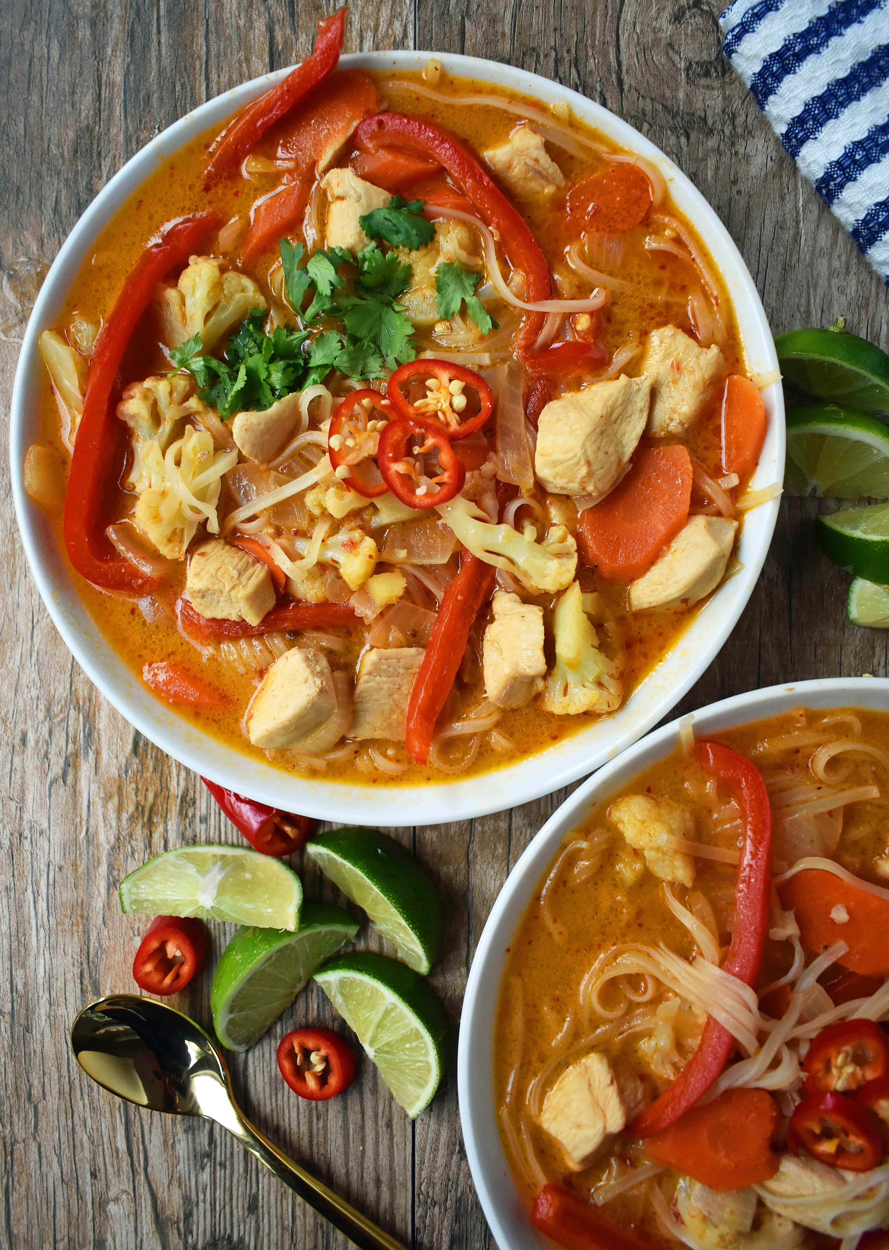 Thai Chicken Noodle Soup. Gluten-free and Dairy-Free nutritious soup that is full of flavor. A rich coconut milk red curry based broth filled with onions, carrots, ginger, cauliflower, and red pepper. A healthy and delicious soup that everyone loves! www.modernhoney.com