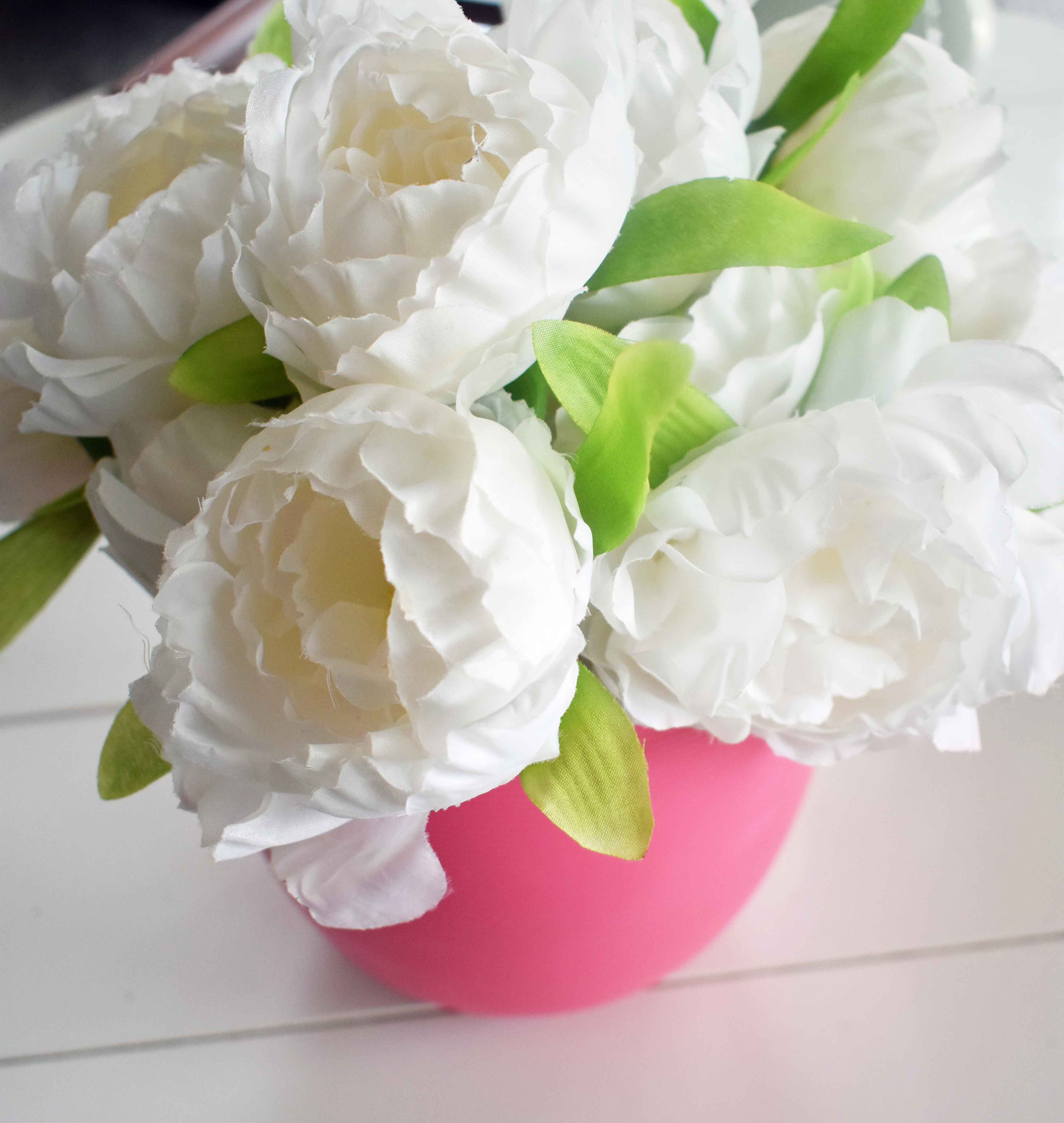 Spring Decoration Ideas. Bright and beautiful white peonies in a pink pot to beautify your home. www.modernhoney.com