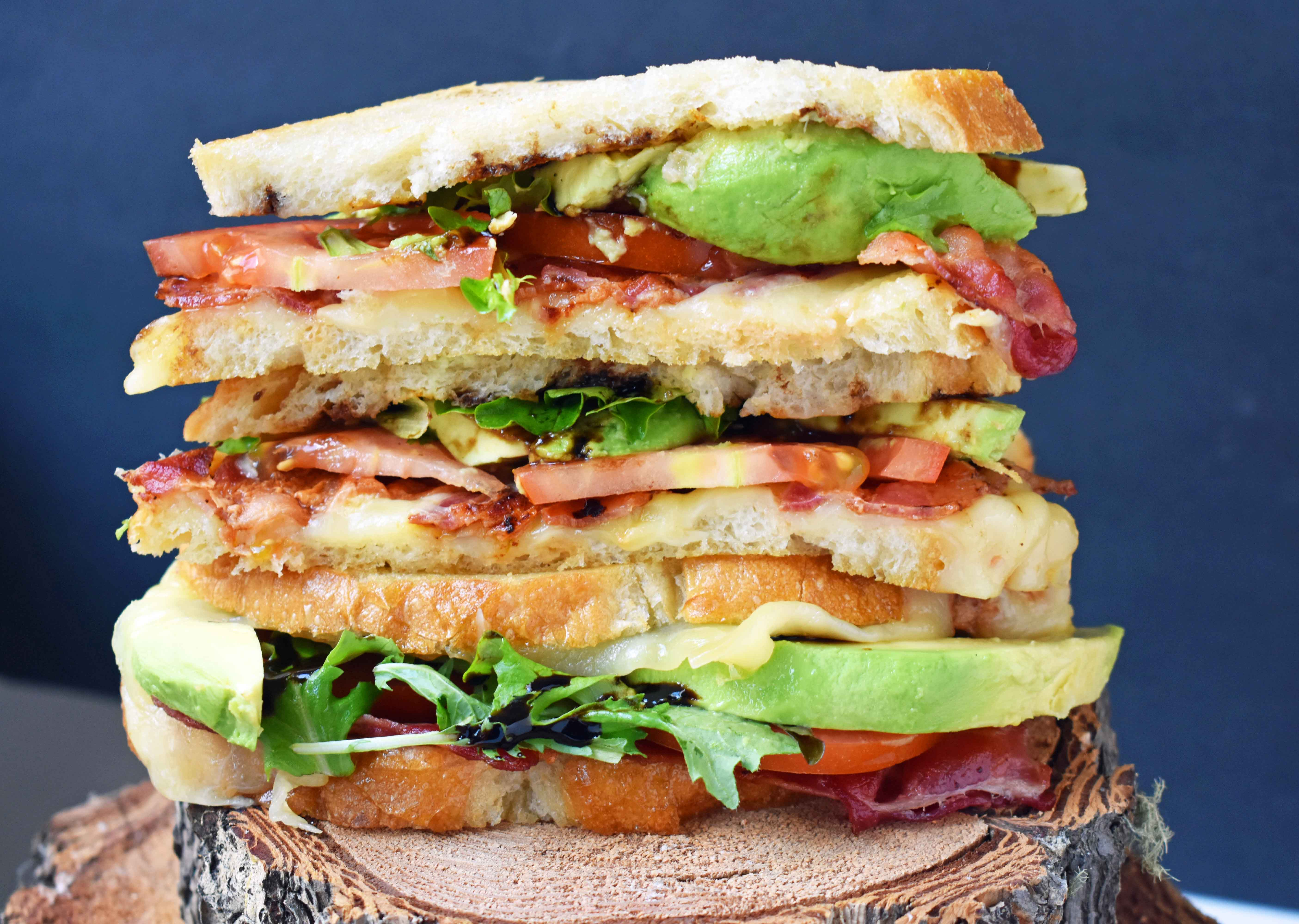 Grown Up Grilled Cheese Sandwich. Three different types of cheese - Swiss, White Sharp Cheddar, and Pepper Jack, crispy bacon, creamy avocado, thinly sliced tomatoes, spring mix, and drizzled with balsamic glaze. A grilled cheese sandwich full of flavor! www.modernhoney.com