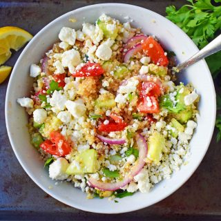 Mediterranean Quinoa Salad with feta cheese, tomatoes, cucumber, and red onions, all tossed in a red wine vinaigrette. www.modernhoney.com