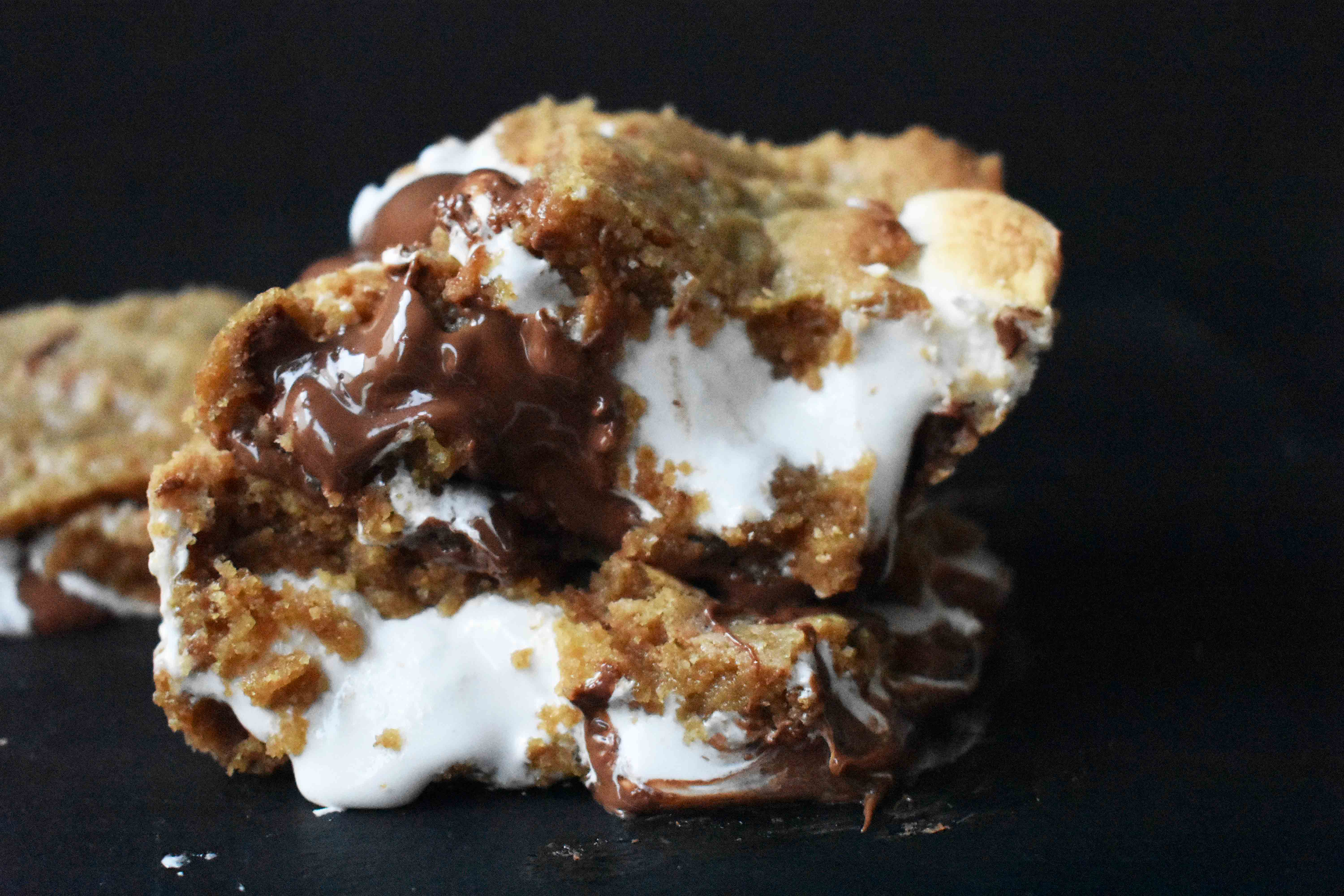 S'mores Bars made with homemade graham cracker cookie dough, marshmallow fluff, and milk chocolate bars. The popular s'more made into a cookie bar. www.modernhoney.com