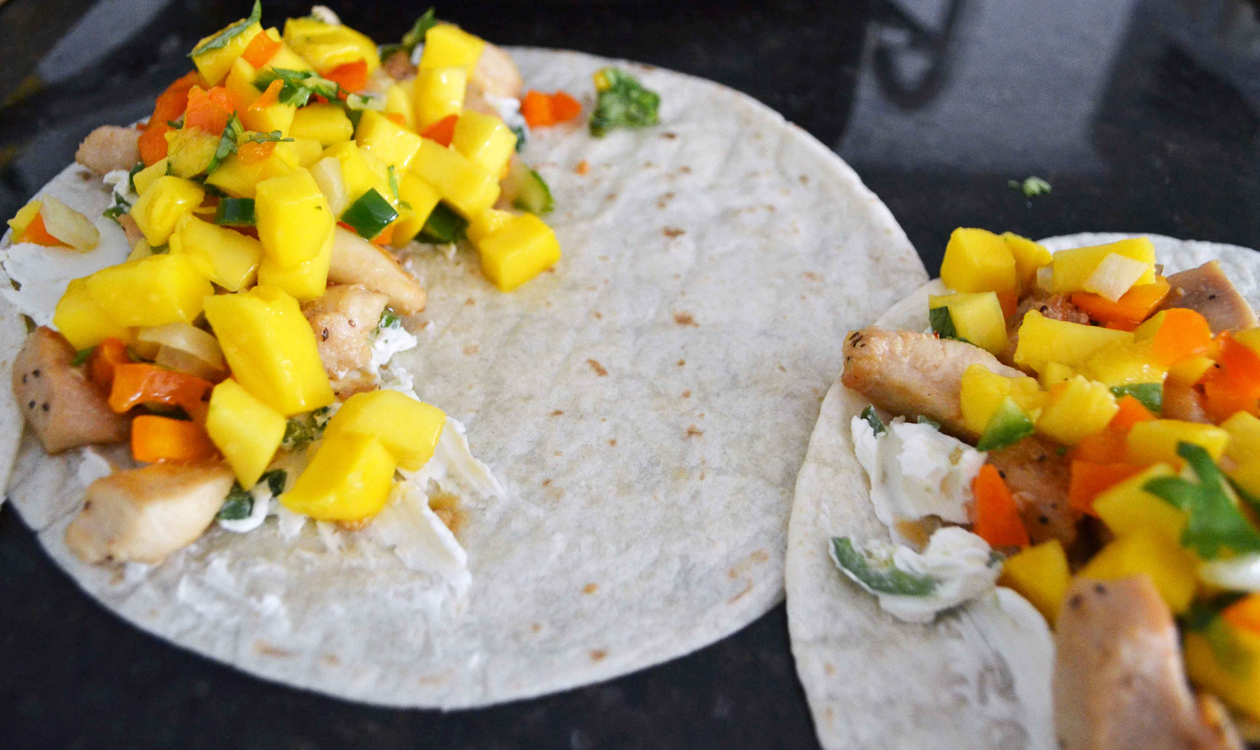 Chicken Mango Quesadillas made with honey lime chicken, homemade fresh mango salsa, pepper jack cheese, and an optional jalapeno cream cheese all melted inside a buttery tortilla. A popular Mexican dinner made in less than 30 minutes. www.modernhoney.com