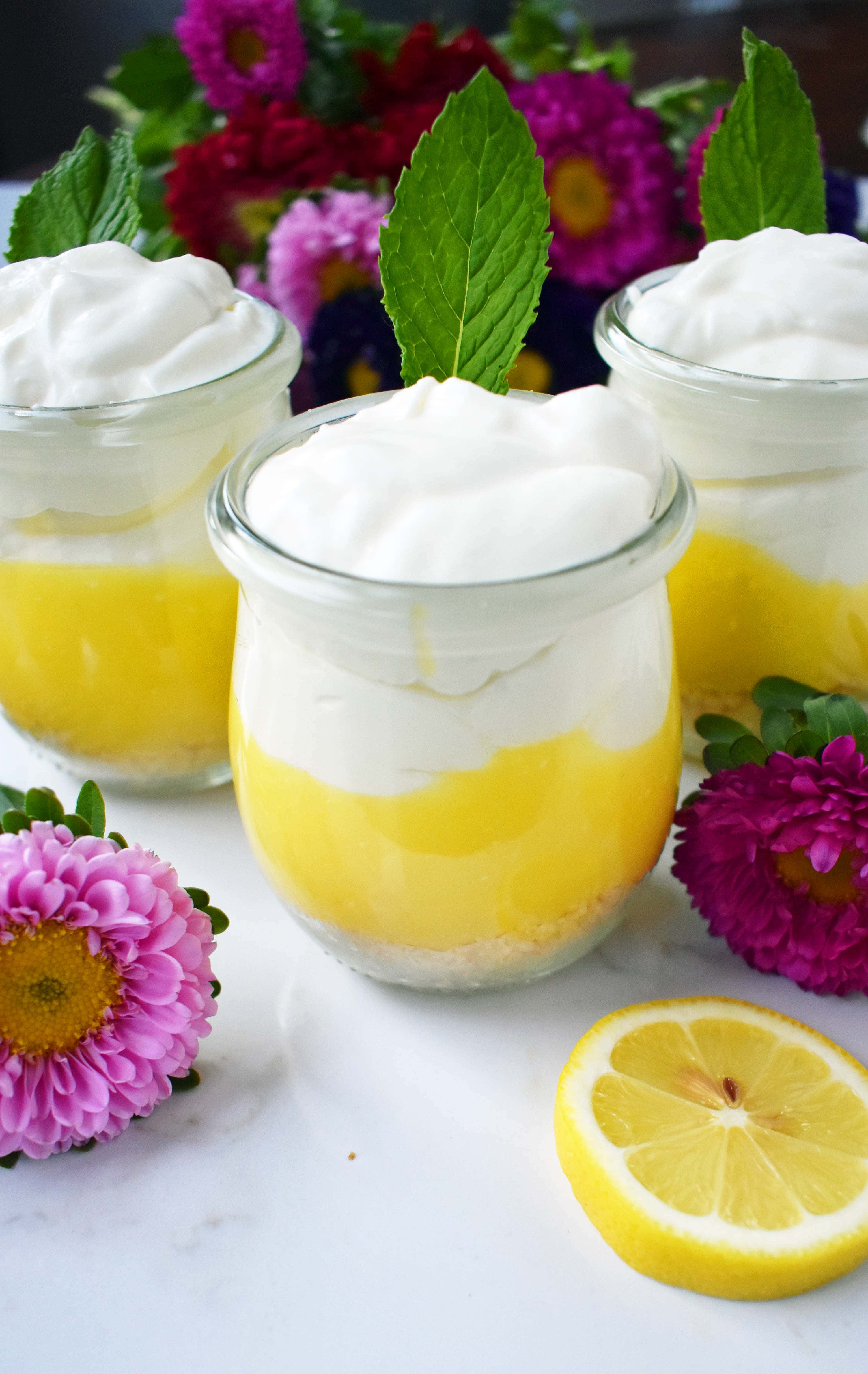 Lemon Cream Parfait Pie Jars. Homemade lemon curd layered with graham or butter cookie crust and sweetened cream cheese and whipped cream. The perfect dessert for parties, Mother's Day, Spring, or Summer parties. It's a lemon cream pie in a jar. Also, tips on how to make it into a 9 inch lemon cream pie. www.modernhoney.com