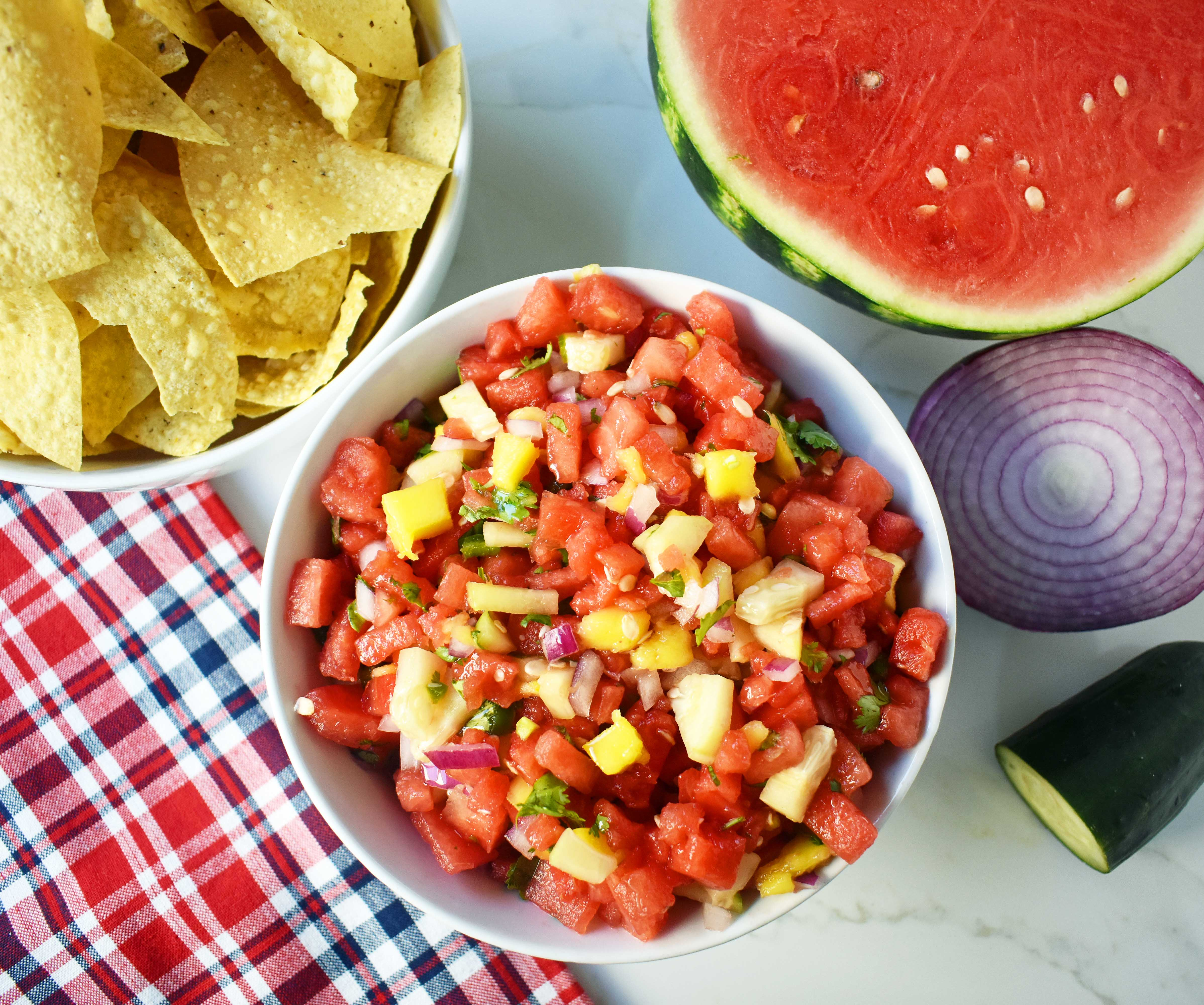 Watermelon Mango Salsa made with fresh watermelon, sweet mango, crisp cucumber, red onion, cilantro, jalapeno and a touch of honey. A sweet and spicy summer salsa. www.modernhoney.com