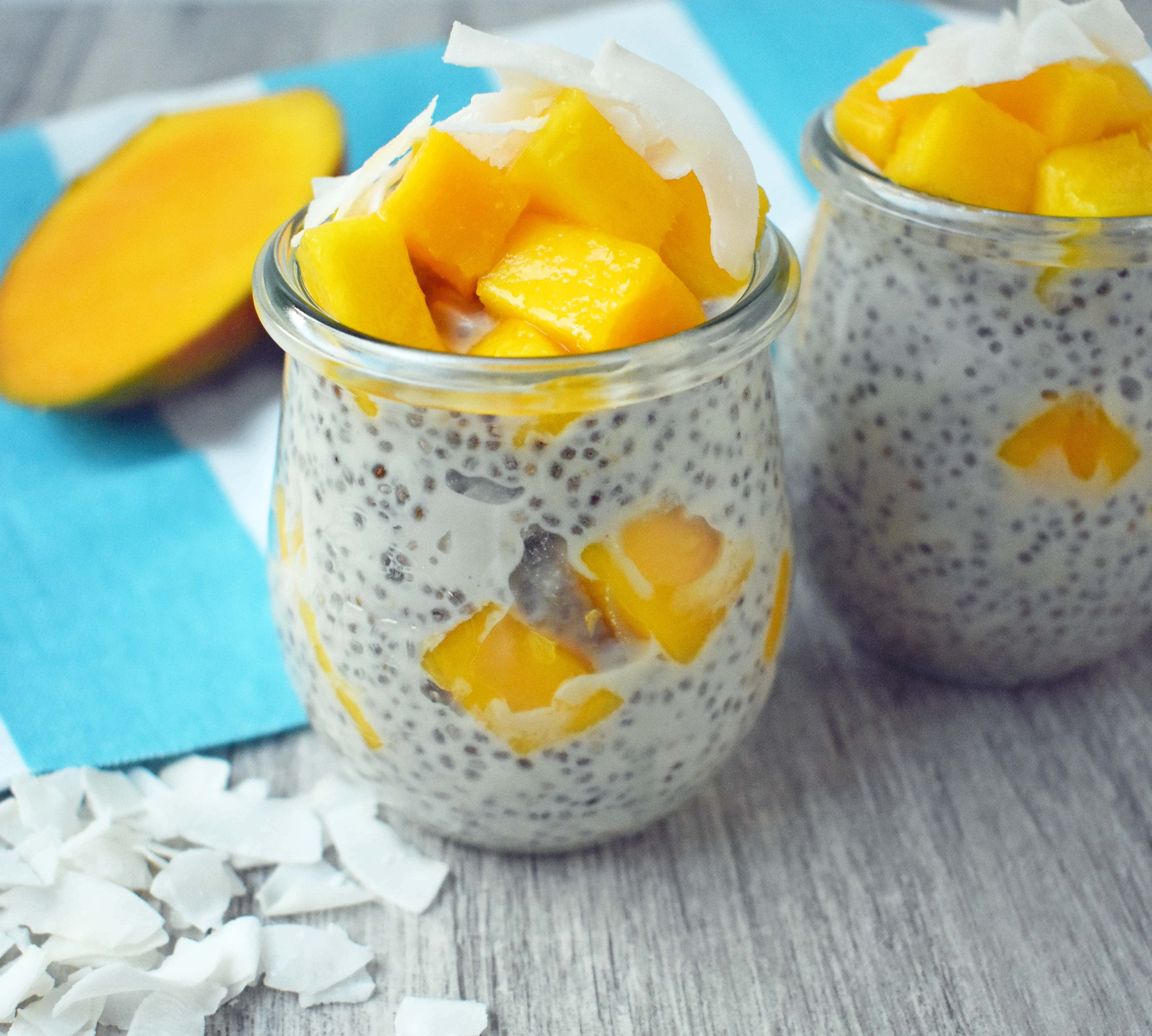 Coconut Mango Chia Pudding. A gluten-free, sugar-free, dairy-free dessert. Omega rich chia seeds soaked in coconut milk and sweetened with real maple syrup. Topped with unsweetned coconut flakes and fresh mango for a healthy tropical treat. www.modernhoney.com