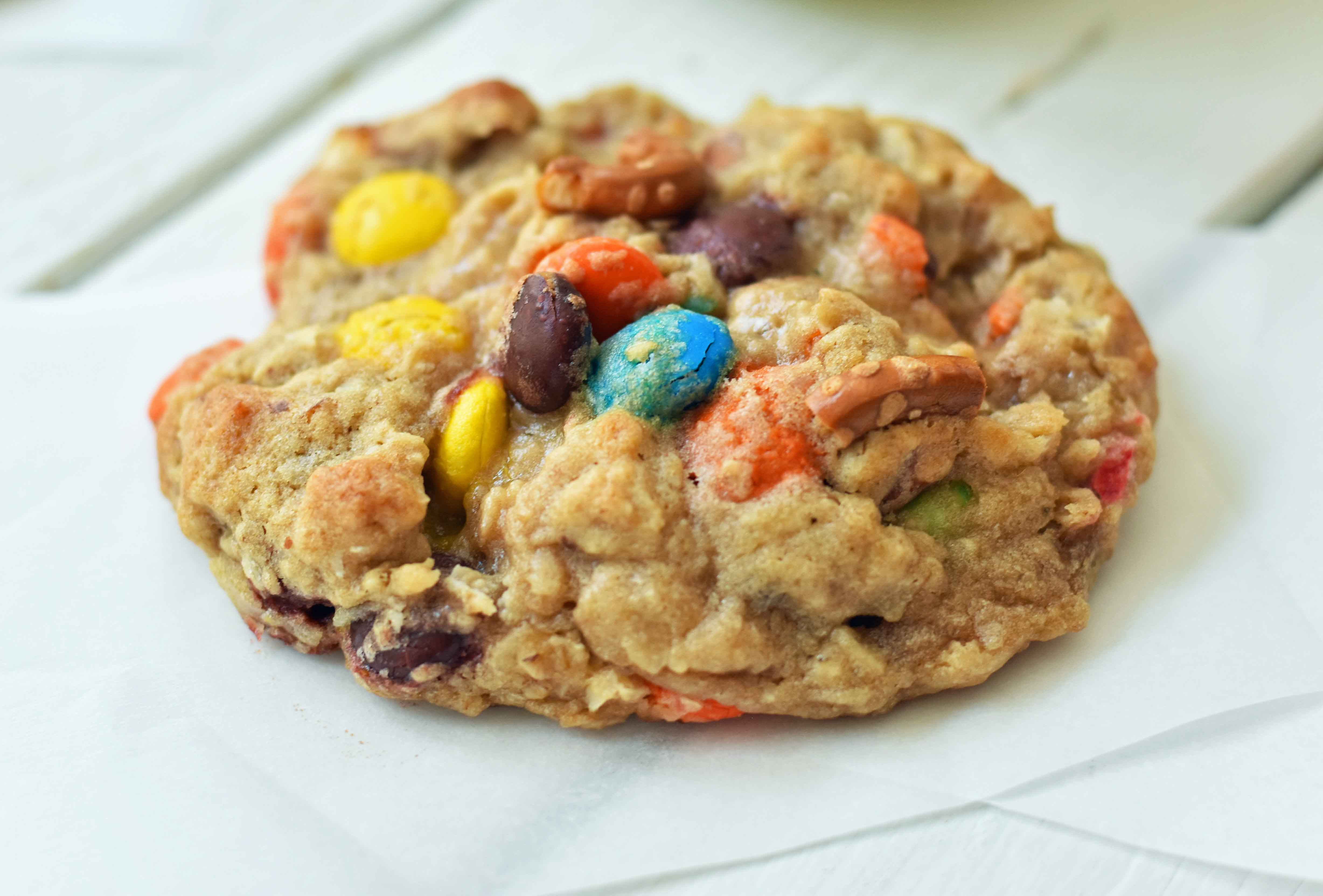 The Overachiever Oatmeal Pretzel M & M Cookie made with a sweet oatmeal cookie dough with oatmeal, shredded coconut, pretzels and M & M's. This Overachiever Cookie is the perfect balance of sweet and salty. www.modernhoney.com