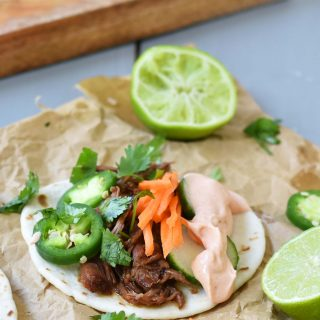 Slow Cooker Instant Pot Korean Beef Tacos. Slowly simmered korean beef with asian spices and topped with crunchy slaw. An easy weeknight dinner that is a huge hit with the family! www.modernhoney.com