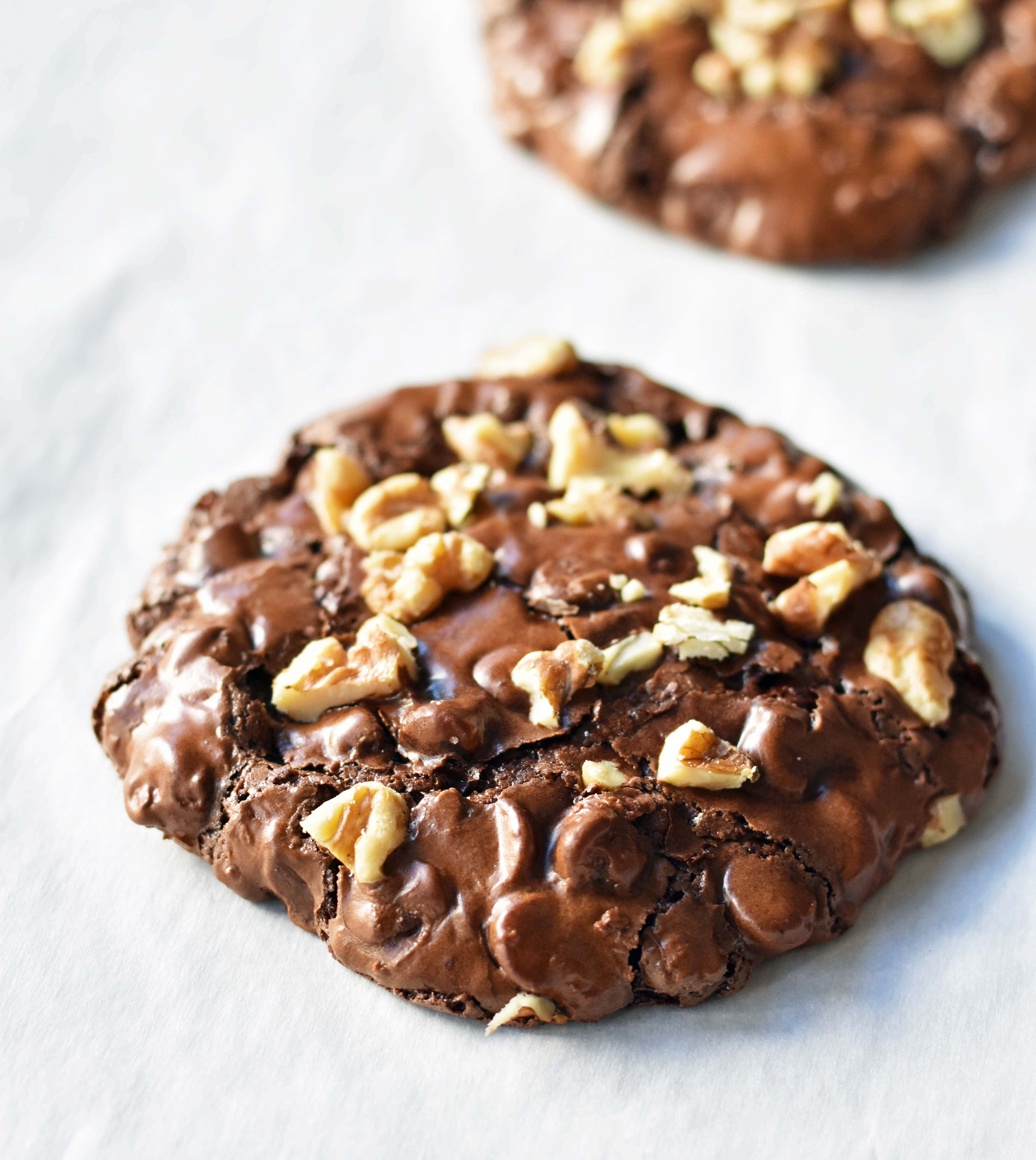 Flourless Chocolate Brownie Gluten Free Cookies are sweet, chewy, crispy, and full of chocolate. If a brownie and a cookie had a baby this would be the result. A fabulous brownie cookie in one! www.modernhoney.com