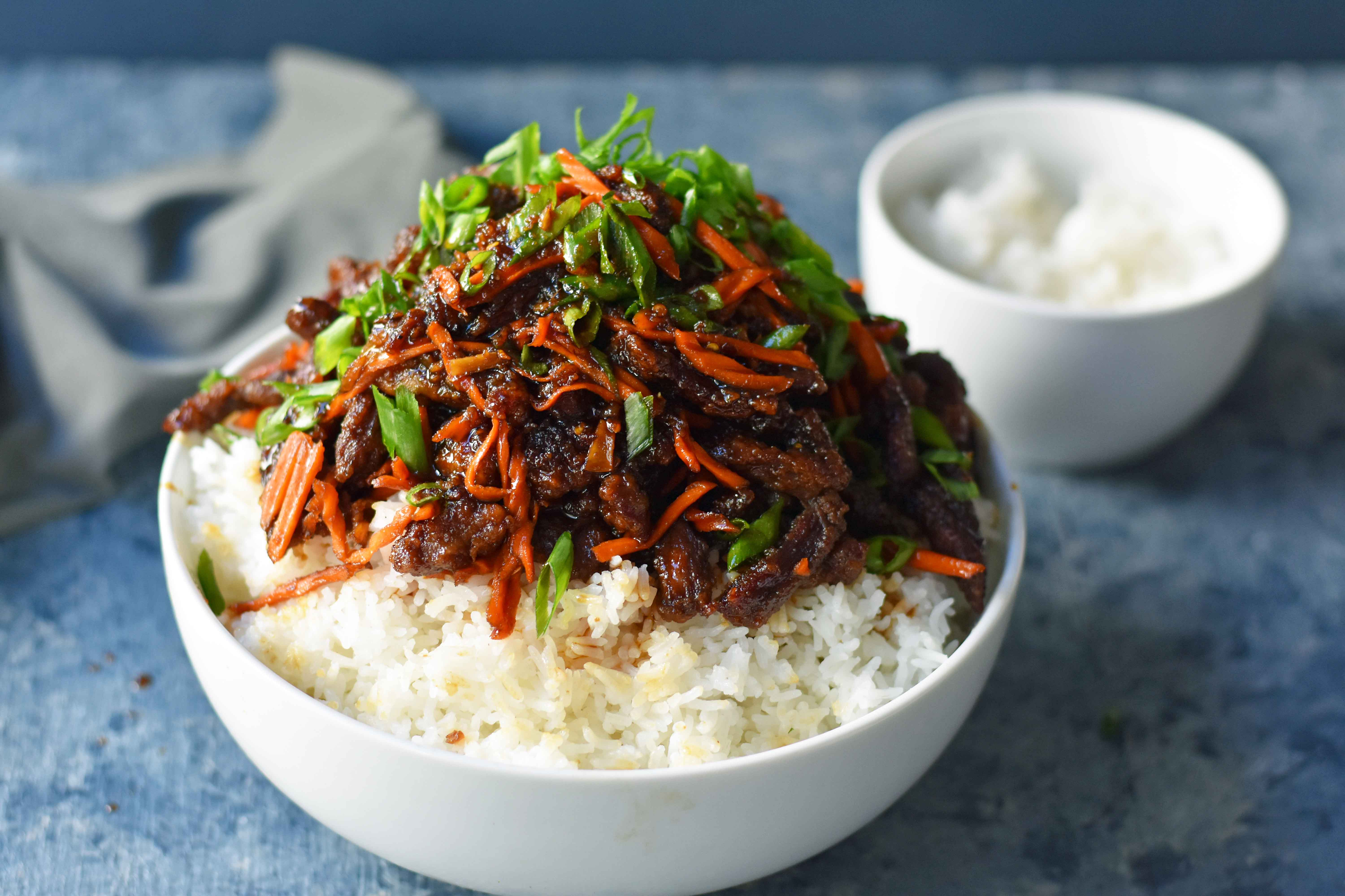 Mongolian Beef recipe. A P.F. Chang's Monglian Beef copycat recipe. Crispy beef in a sweet, salty, spicy sauce on a bed of rice. A popular asian dish. www.modernhoney.com