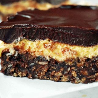No-Bake Nanaimo Bars. A popular Canadian dessert bar made with a chocolate coconut graham cracker crust, creamy custard filling, and decadent chocolate layer. A 5 star dessert bar. www.modernhoney.com
