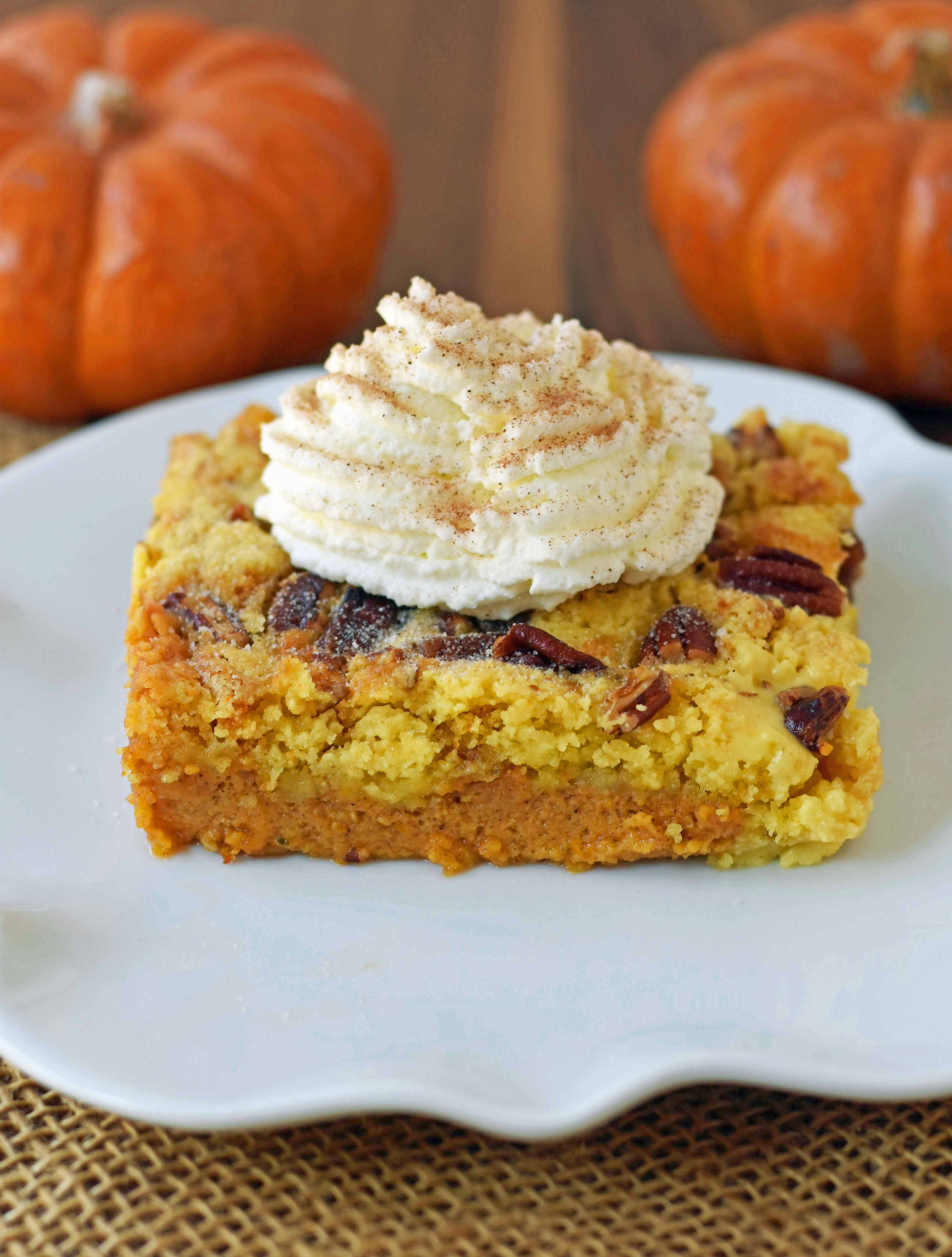 Pumpkin Praline Butter Dump Cake. Pumpkin custard filling baked with a buttery crunchy cake topping. This is the perfect pumpkin Fall dessert. www.modernhoney.com