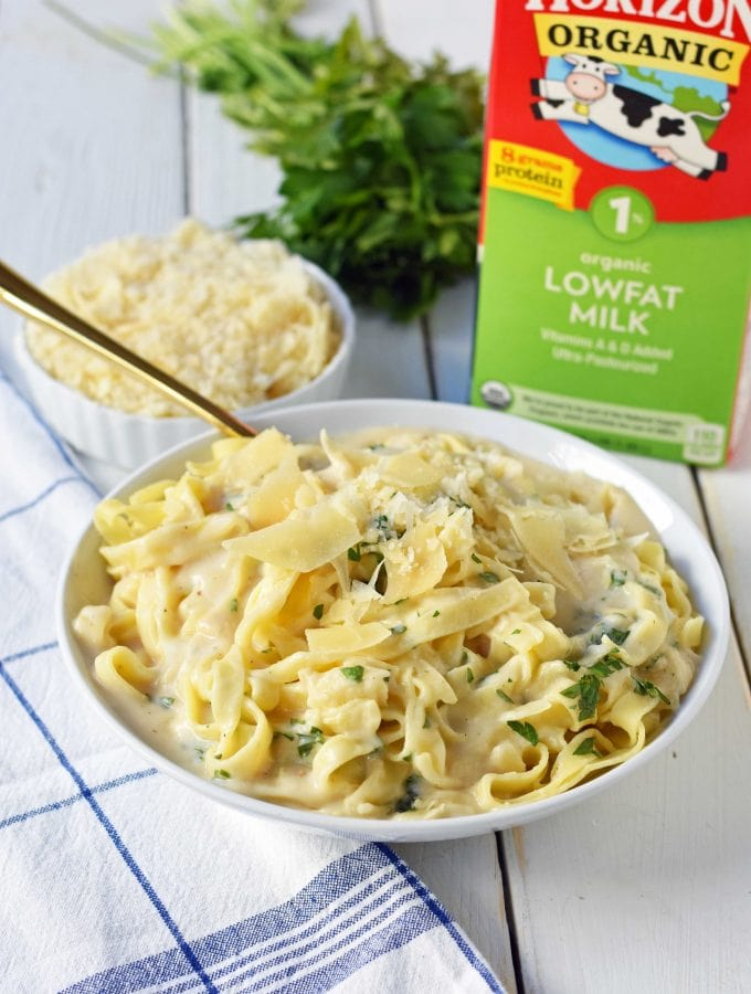 Skinny Fettuccine Alfredo is a low-fat version of America's favorite pasta dish. Rich and creamy fettuccine alfredo without all of the fat. This skinny fettuccine alfredo sauce is made with milk instead of heavy cream and has all of the flavor as the original. A 30-minute healthy meal that kids love. www.modernhoney.com