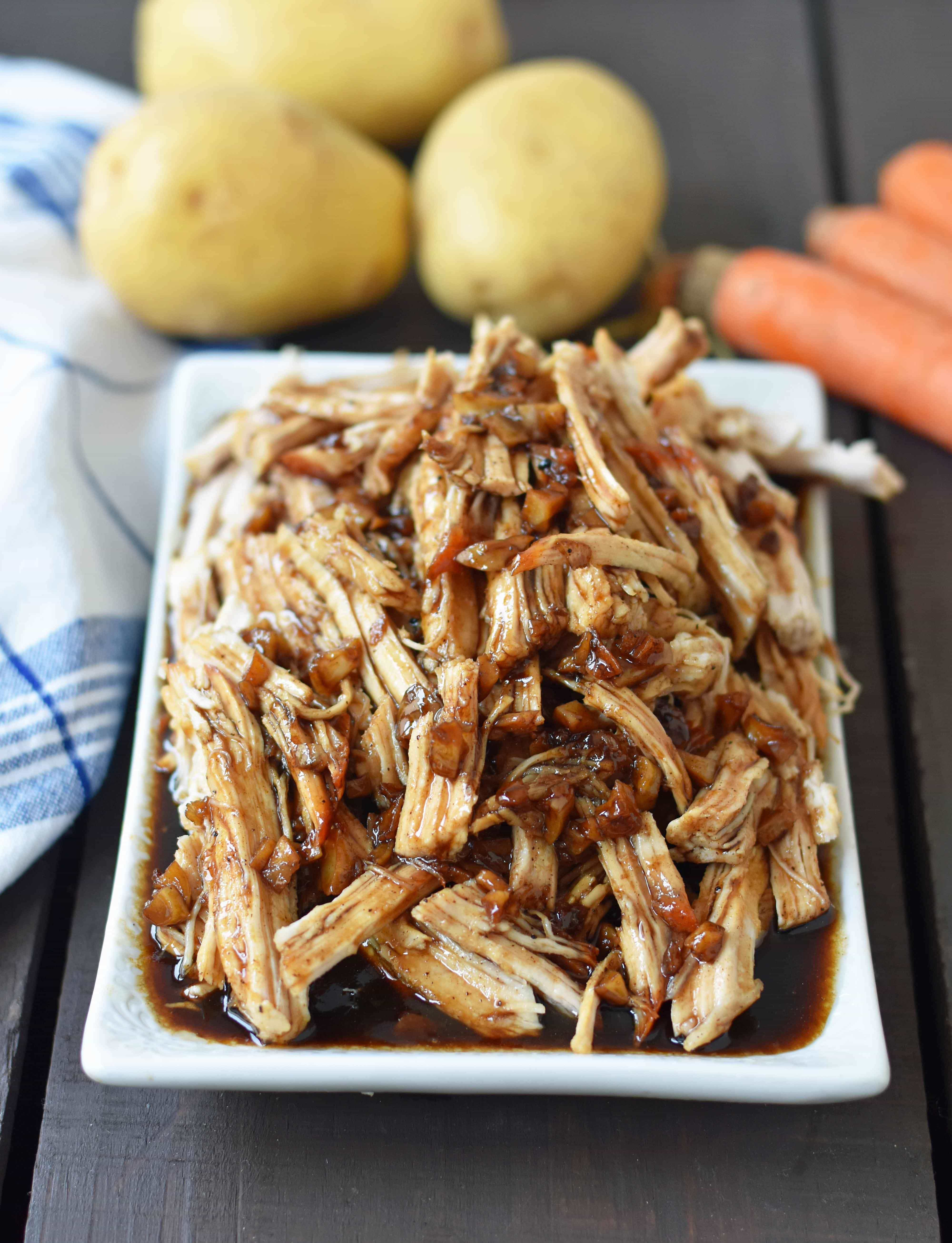 Brown Sugar Balsamic Pork. Tender lean pork loin slow cooked in a brown sugar garlic balsamic glaze. An easy flavorful meal made in a slow cooker or instant pot. www.modernhoney.com