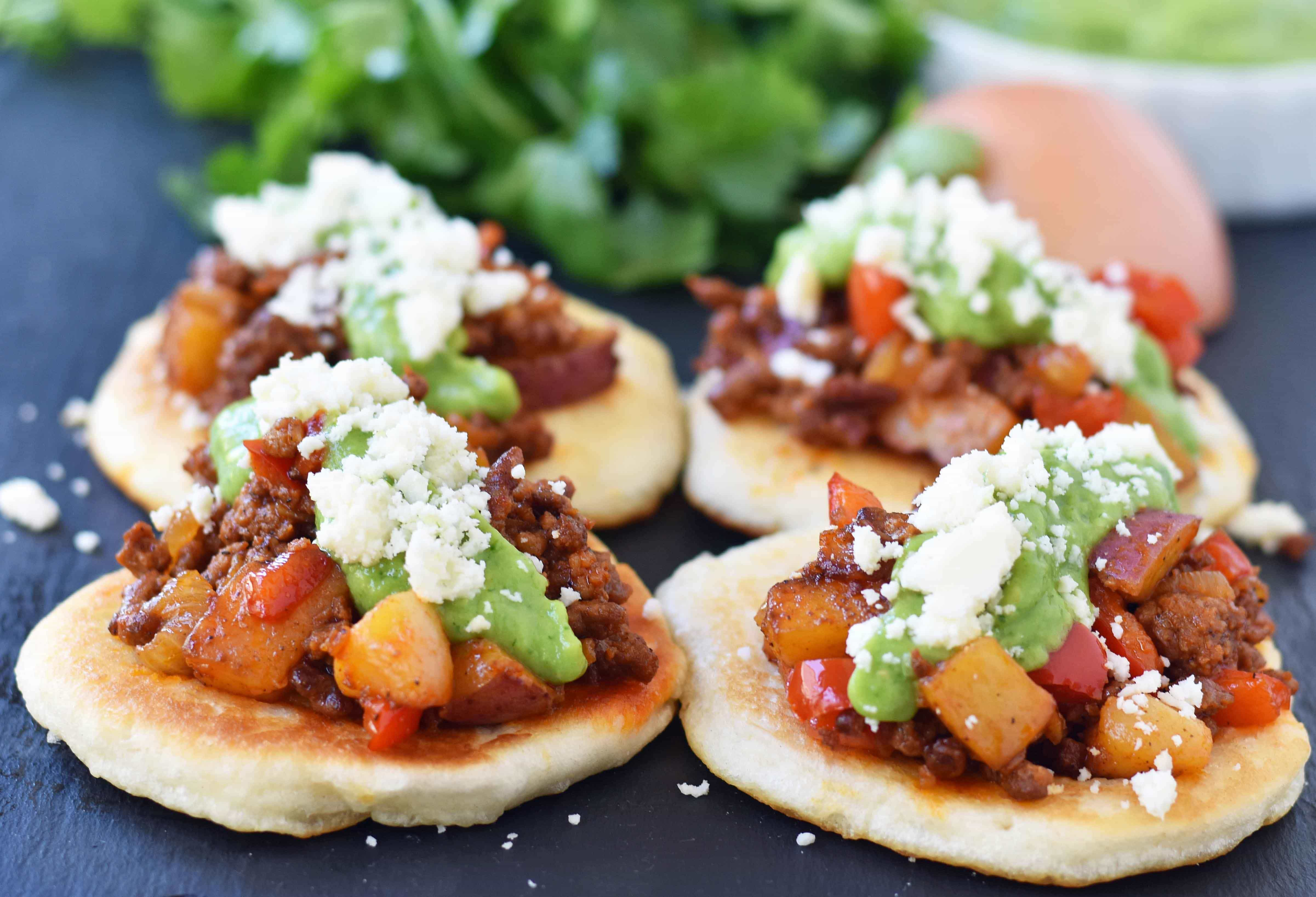 Chorizo Potato Puffy Tacos from Melissa Stadler 46th Pillsbury Bake-Off Contest. Puffy Tacos made with Pillsbury biscuit dough and filled with spicy chorizo, seasoned potatoes and peppers, a creamy avocado tomatillo crema, and cotija cheese. www.modernhoney.com