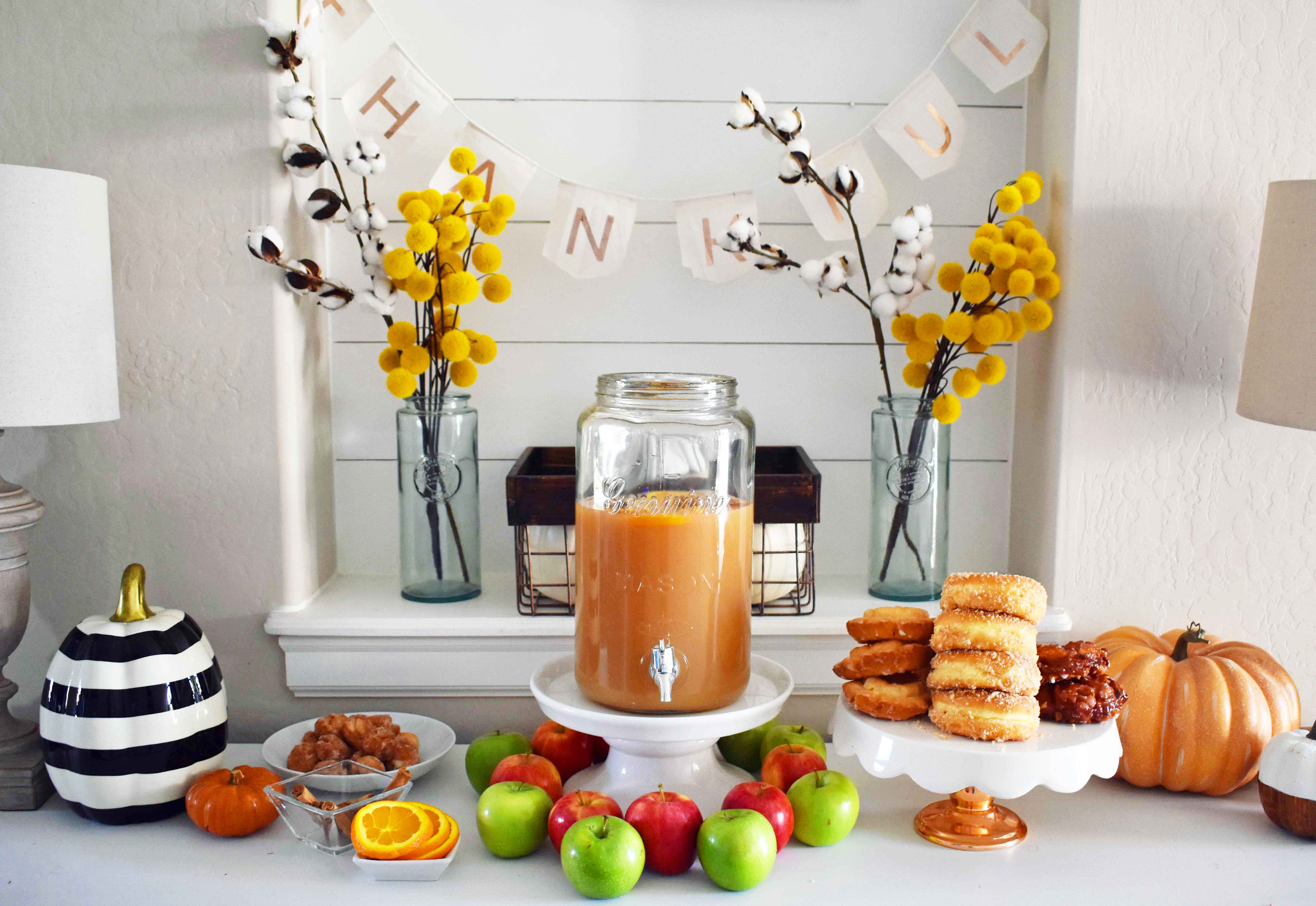 How to make a DIY Hot Apple Cider Bar to celebrate Fall. A simple, easy way to serve hot apple cider and a homemade apple fritters recipe. A hot apple cider bar with all of the toppings. www.modernhoney.com