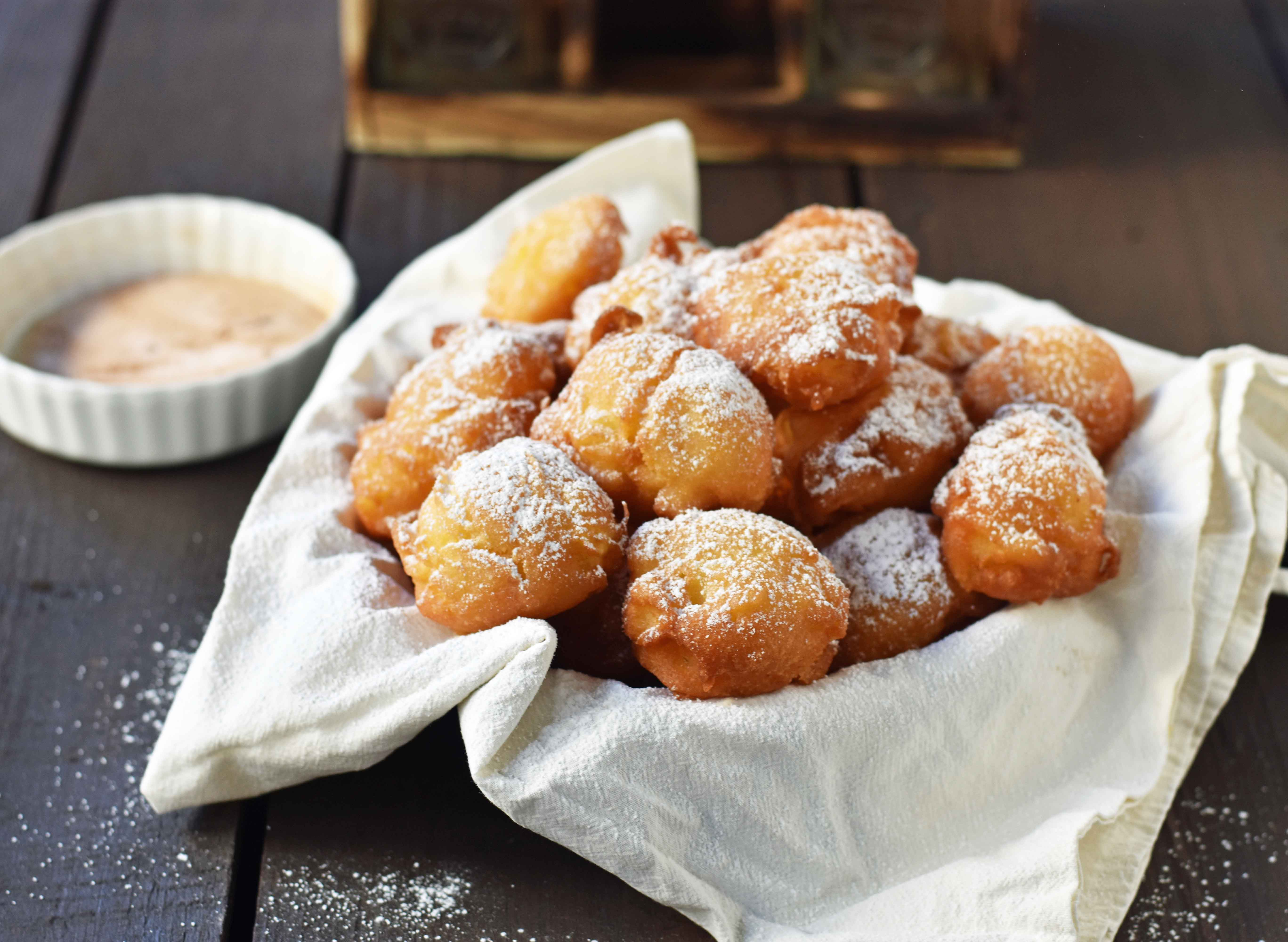 How to make quick and easy homemade apple fritters from scratch. A simple apple batter fried in oil and topped with powdered sugar, cinnamon sugar, or vanilla glaze. Can be dipped in homemade creme anglaise or pastry cream. A festive Fall dessert. www.modernhoney.com